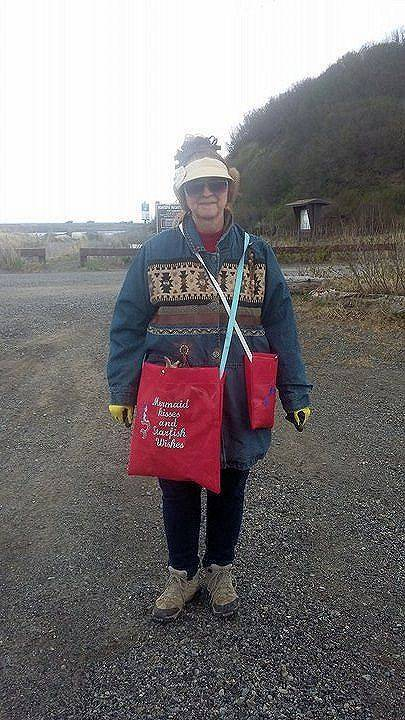 June Searcy-Josten, of Happy Valley, gears up for a day of beachcombing in the cold wind with a large bag for driftwood and smaller bags for miscellaneous shells and rocks. (Photo courtesy/June Searcy-Josten)