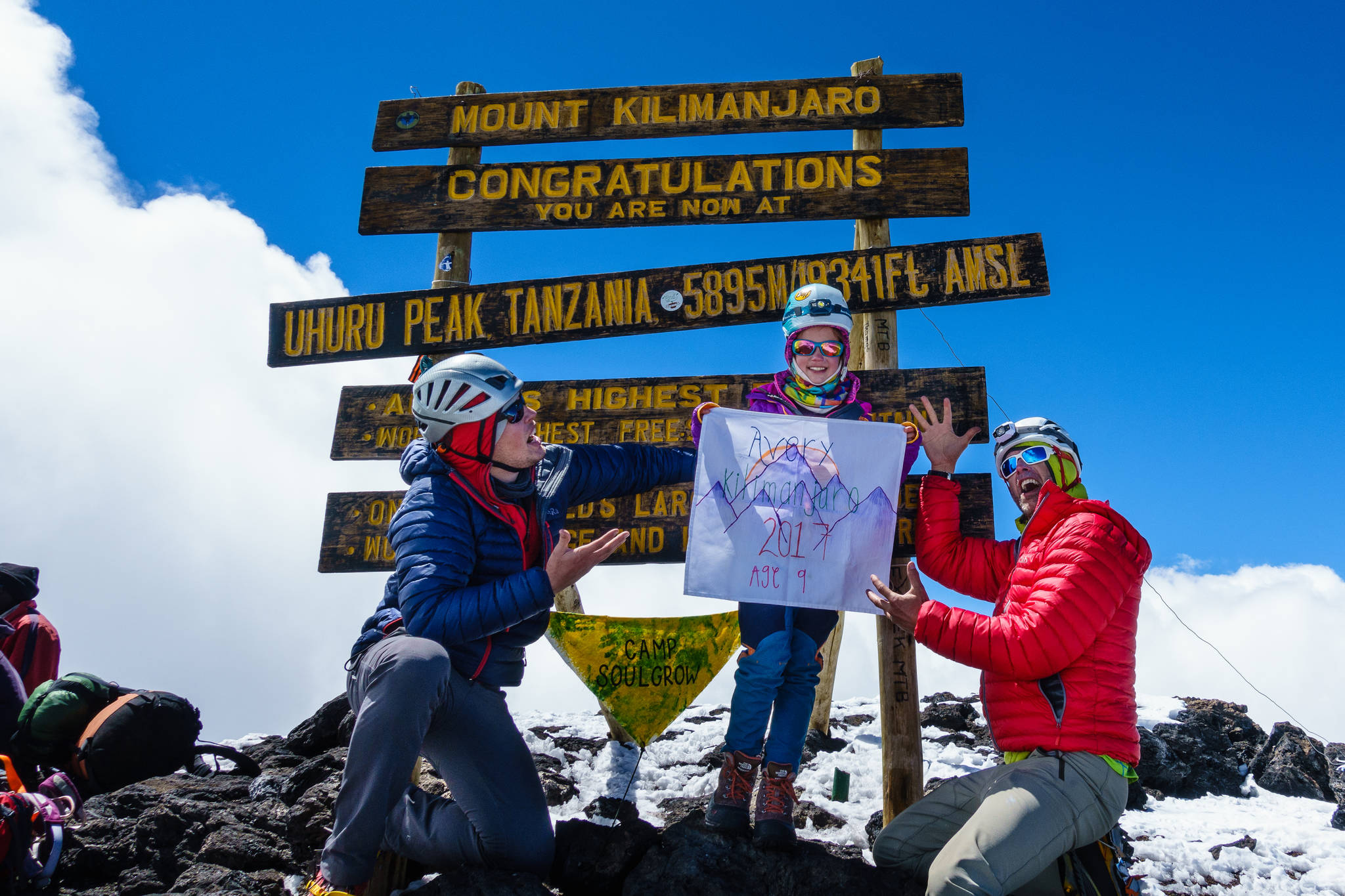 Avery Walden, then 9, poses at the peak of Mt. Kilimanjaro in Tanzania with her father Chris Walden (right) and a family friend on Jan. 6, 2017. The group climbed the famous mountain in January, making Avery the youngest female to ascend the mountain. (Photo courtesy Chris Walden)