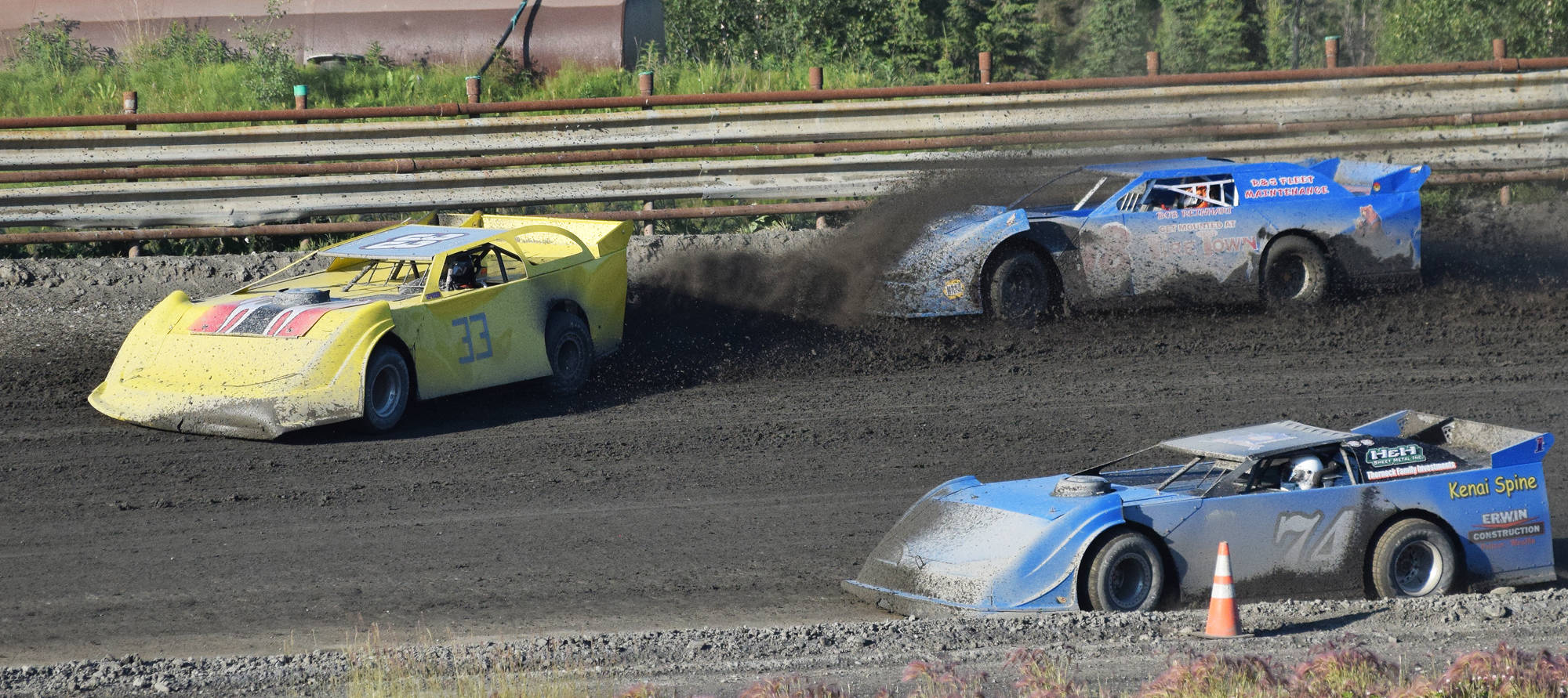 Jason Magers (33) kicks up dirt onto the windshielf of a fellow Late Models racer as Al Ulman (74) drives by during the running of the Alaska Dirt Track Shootout held Saturday at Twin City Raceway in Kenai. (Photo by Joey Klecka/Peninsula Clarion)