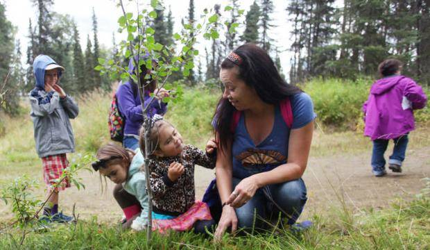 (Left to right) Kalista, Shaunzi and Kimbra Clements crouch in a patch of low bush cranberries Aug. 15, 2016 on Tsalteshi Trails' Wolverine Trail in Soldotna, Alaska during the Harvest Moon Festival. (Clarion File Photo)