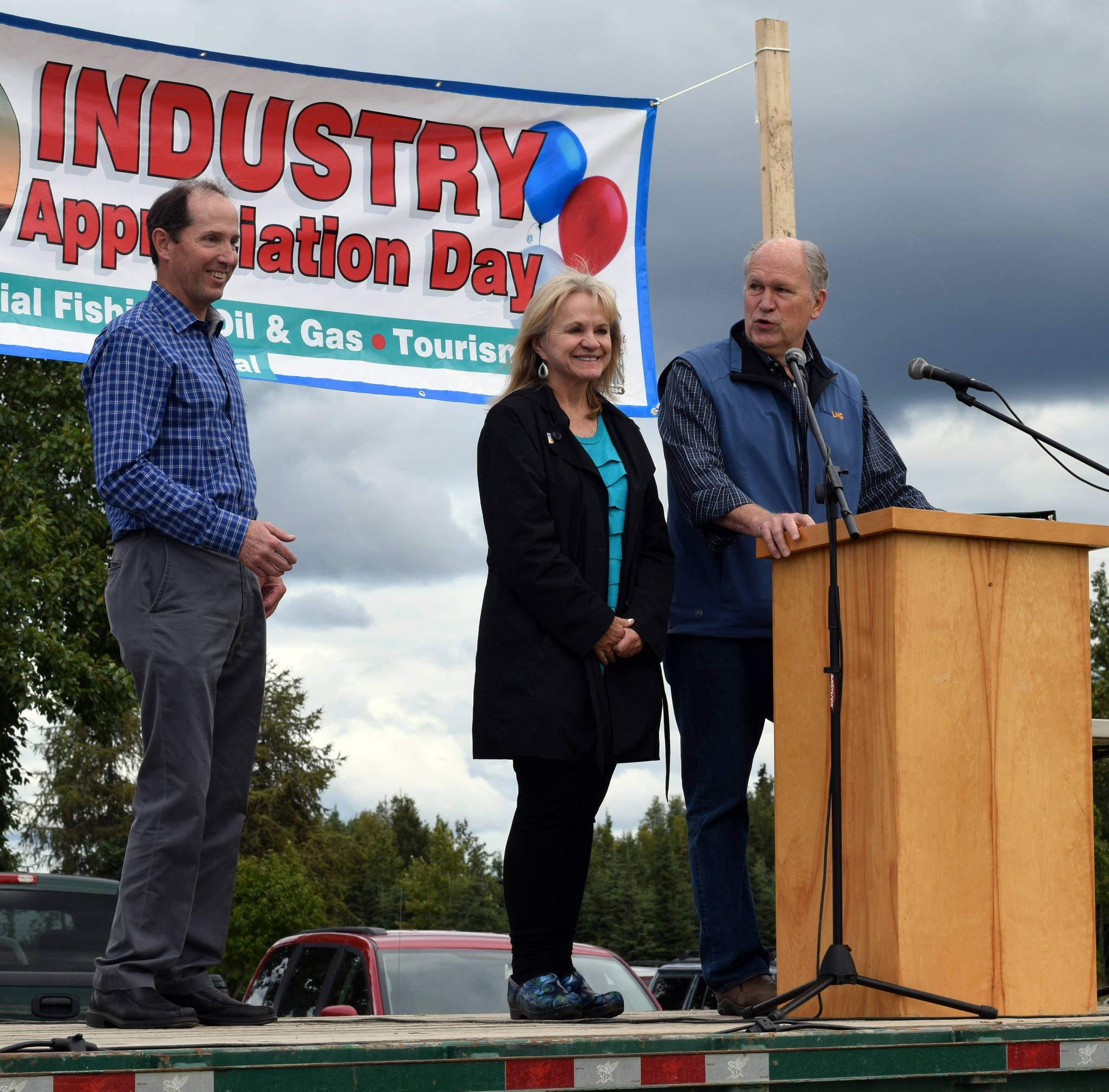 Governor Bill Walker, right, his wife, Donna and Kenai Peninsula Borough Mayor Mike Navarre take the stage during Industry Appreciation Day on Saturday, Aug. 26, 2017 in Kenai, Alaska. (Photo by Kat Sorensen/Peninsula Clarion)