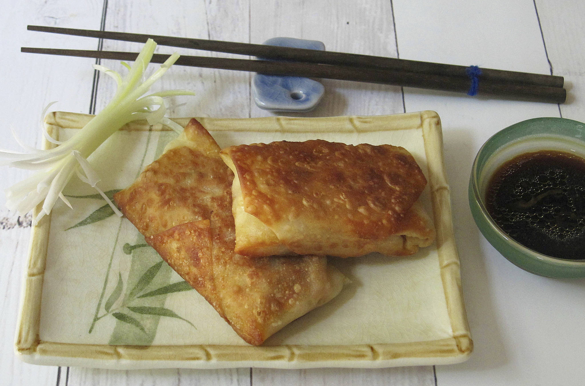 """This August 2017 photo shows """"not fried egg rolls"""" in New York. This dish is from a recipe by Sara Moulton. (Sara Moulton via AP)"""