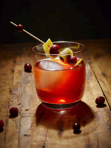 """This 2017 photo provided by The Culinary Institute of America shows a """"Cortland Jab"""" cider cocktail in Hyde Park, N.Y. This drink is from a recipe by the CIA. (Phil Mansfield/The Culinary Institute of America via AP)"""