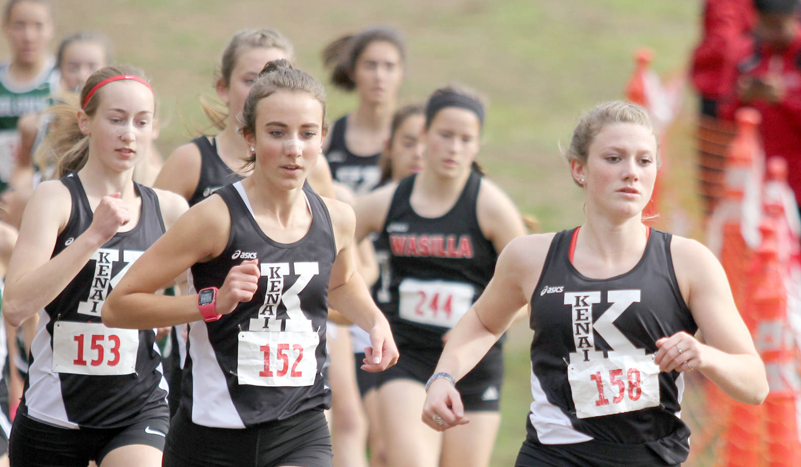 Kenai Central senior Addison Gibson leads a trio of Kards early in the varsity girls' race of the Wasilla Invitational Saturday, Sept. 9, 2017, at the Government Peak Recreation Area near Palmer. Gibson finished second. From left are Jaycie Calvert, Brooke Satathite and Riana Boonstra. (Photo by Jeremiah Bartz/Frontiersman)