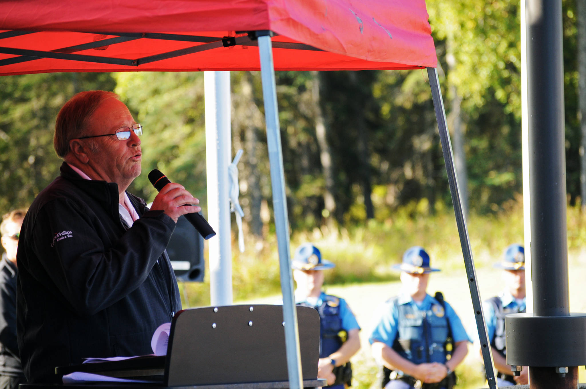 In this Sept. 9, 2016 photo, Rep. Mike Chenault (R-Nikiski) speaks at a flagpole dedication ceremony at the Nikiski Senior Center in Nikiski, Alaska. Chenault filed a letter of intent Tuesday to seek office in October 2018 and said he was gauging statewide support for a run for governor. (Photo by Elizabeth Earl/Peninsula Clarion, file)