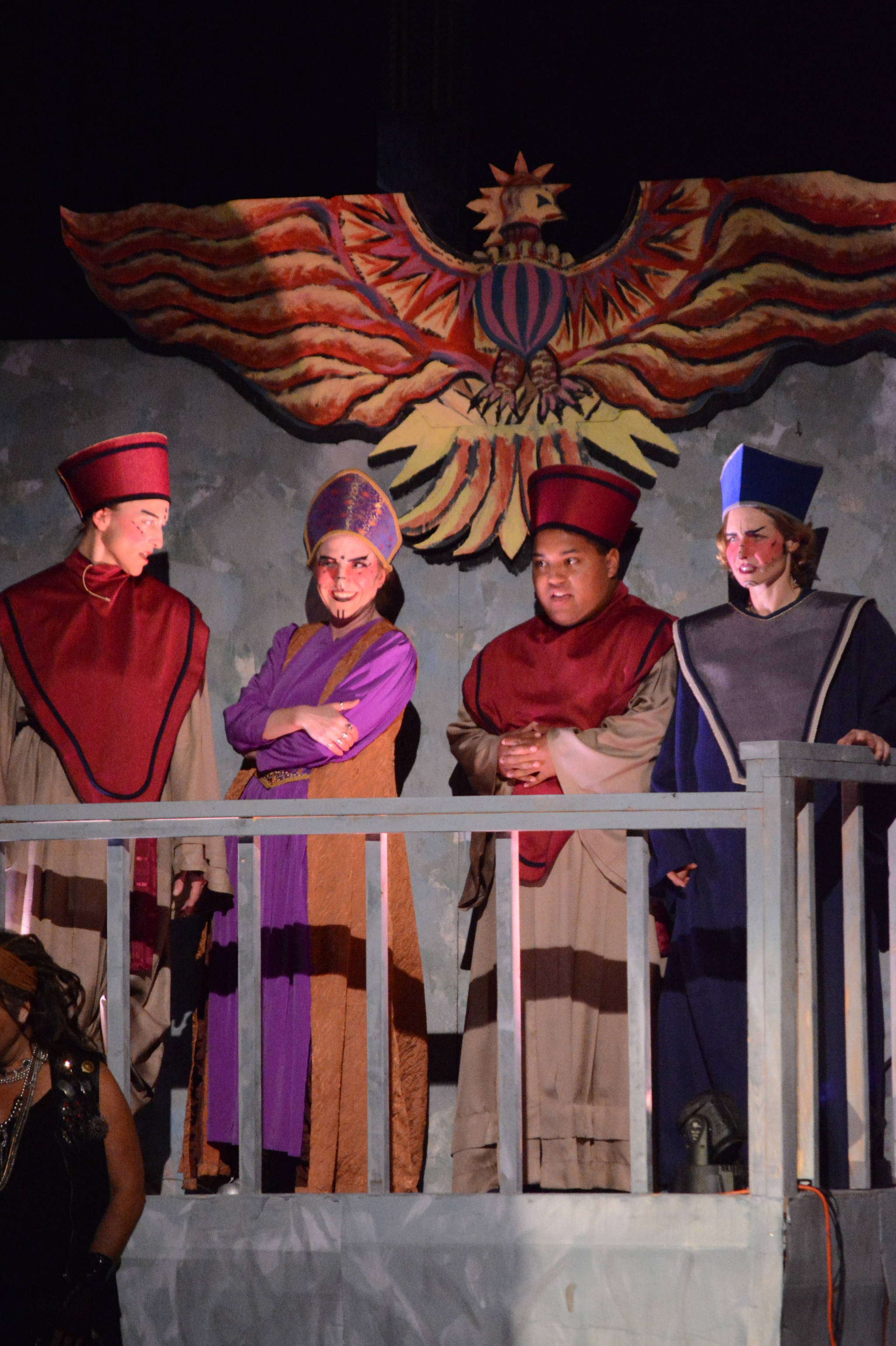 """Susan Cates Blackmon, second from left, as Caiaphas, and Adele Person, left, Falcom Greear, second from right, and Jenny Medley, right, all as priests, rehearse a scene from """"Jesus Christ Superstar"""" on Monday, Oct. 2, 2017 at Mariner Theatre in Homer, Alaska. The musical opens Friday, Oct. 6. (Photo by Michael Armstrong, Homer News)"""