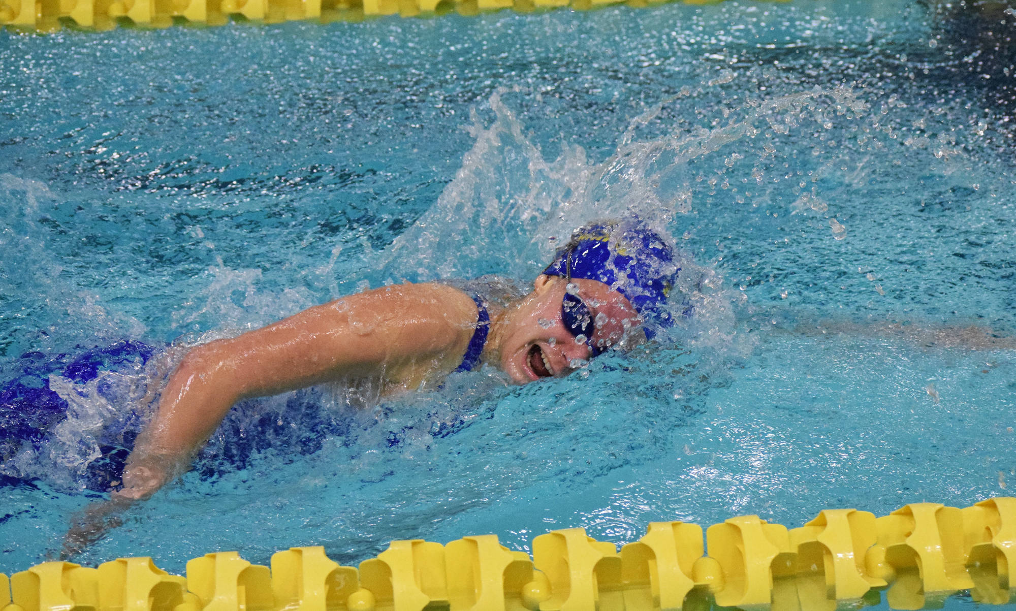 Homer's Madison Story races in the girls 200-yard Individual Medley Saturday at the ASAA First National Bank State Swimming & Diving Championships at the Bartlett High pool. (Photo by Joey Klecka/Peninsula Clarion)