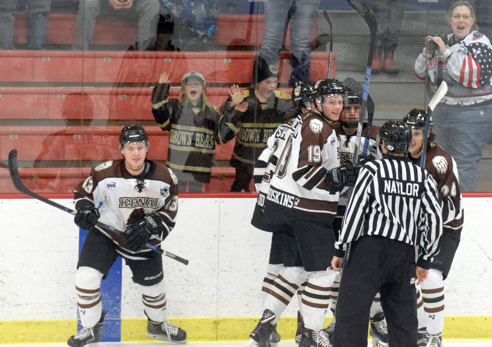 Kenai River's Luke Radetic (far left) and linemates celebrate his goal just 20 seconds into the game Friday, Nov. 10, 2017, at the Soldotna Regional Sports Complex. (Photo by Jeff Helminiak/Peninsula Clarion)