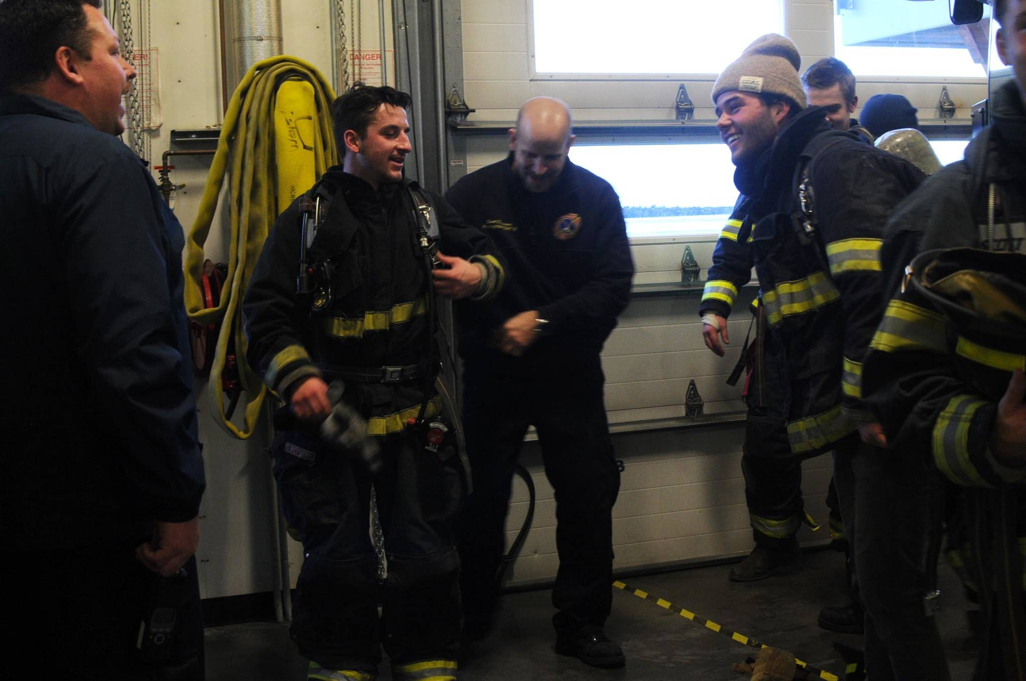 Kenai Fire Marshal Tommy Carver talks to the Kenai River Brown Bears hockey team players during a tour and training demonstratoin at the Kenai Emergency Operations Center on the Kenai Municipal Airport on Tuesday, Nov. 28, 2017 in Kenai, Alaska. Kenai Fire Department firefighters walked the Brown Bears players through some of the training and tools firefighters use to give them an idea of what a career in fire response is like. (Photo by Elizabeth Earl/Peninsula Clarion)