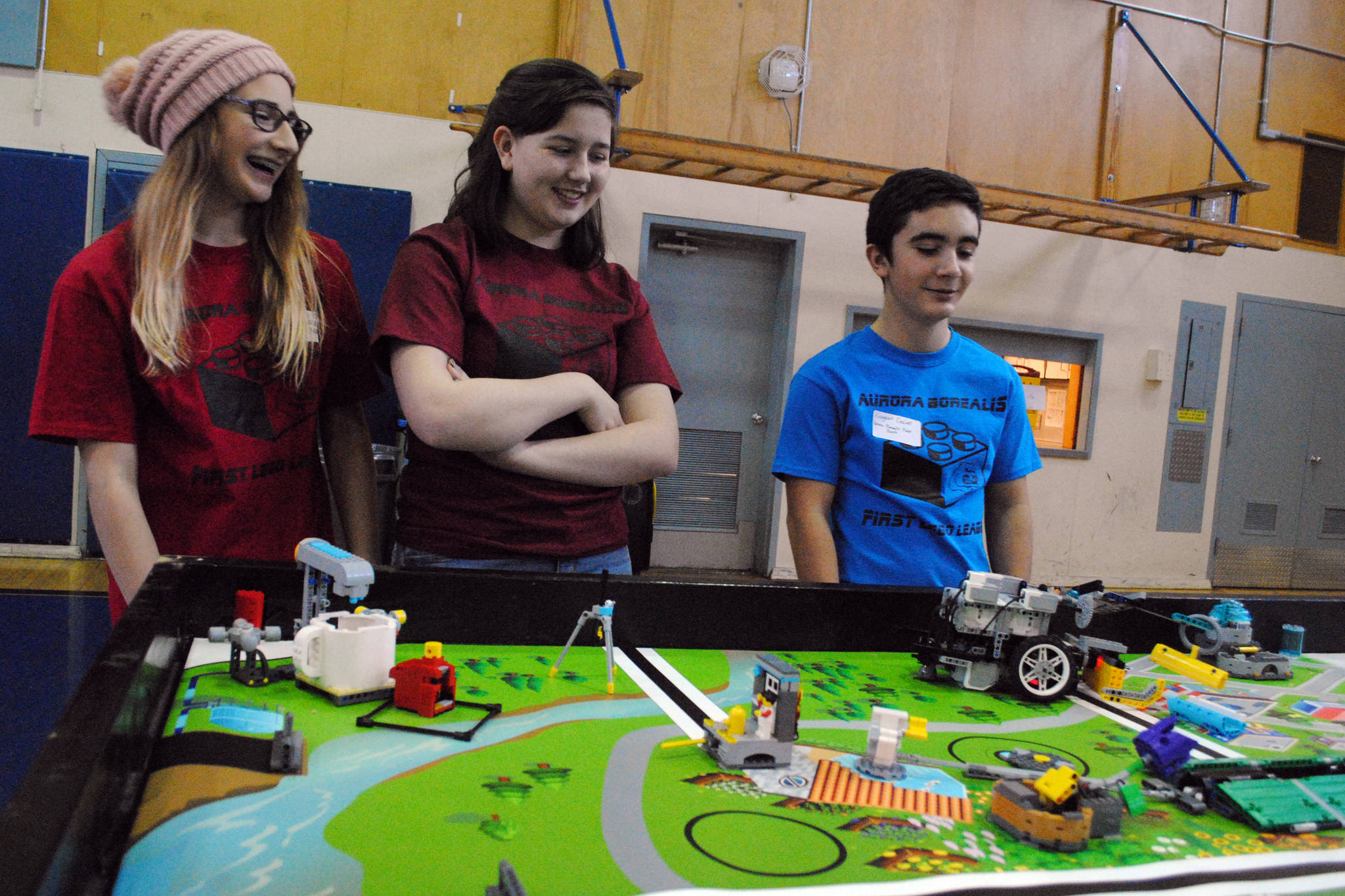 Team members from the Aurora Borealis 'Polar Bears' practice their robots programming during Saturday's First Lego League at Aurora Borealis Charter School. The competition challenges students to solve an issue with legos, teamwork and some engineering. The team went home with the Champion's Award and will continue on to the state competition in Anchorage. (Photo by Kat Sorensen/Peninsula Clarion)