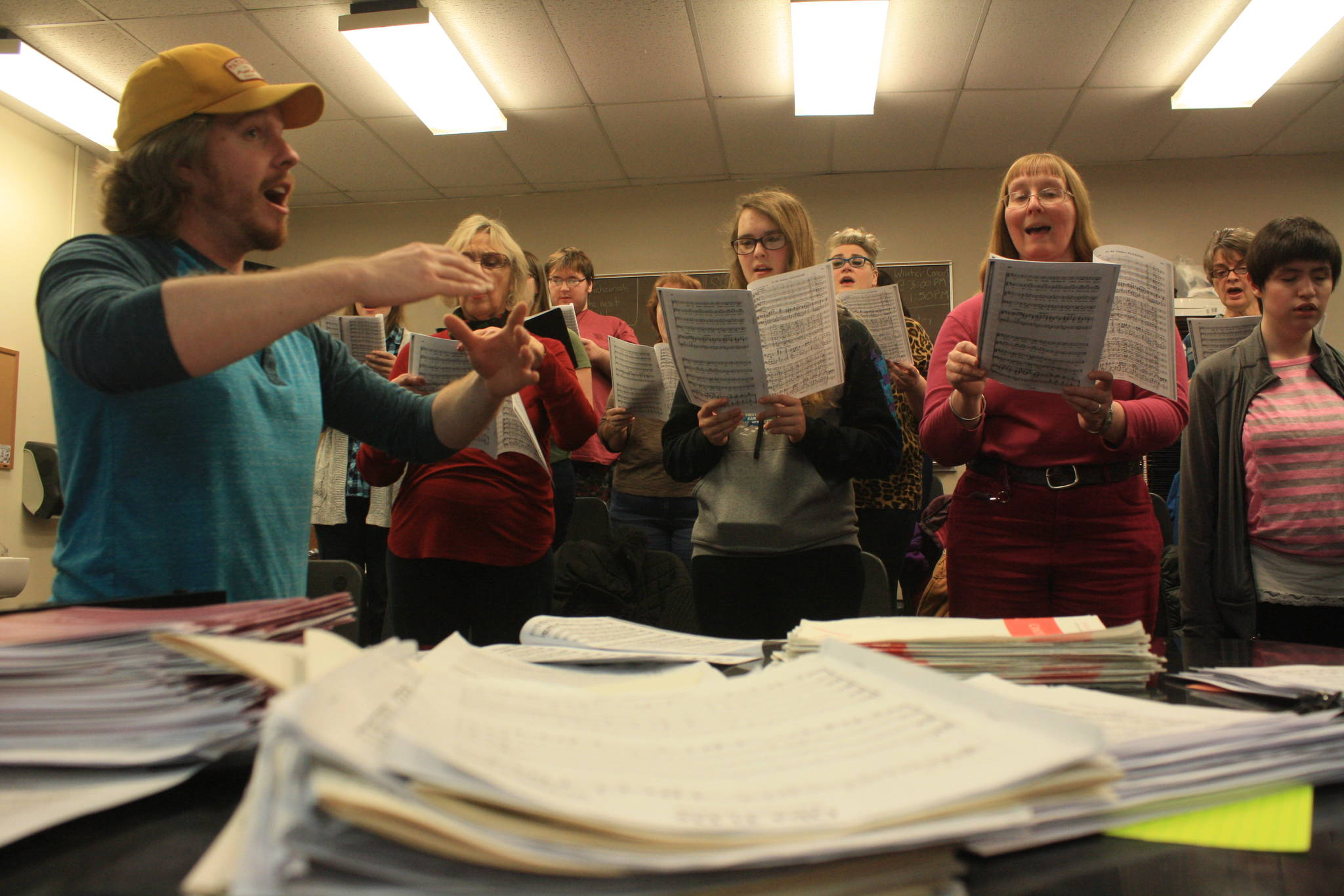 Kenai Central High choir teacher Simon Nissen conducts the Kenai Peninsula Singers during a rehearsal on Dec. 11. The Peninsula Singers and Redoubt Chamber Orchestra will perform together in the 2017 Evening of Christmas on Friday, Dec. 15. (Photo by Erin Thompson/Peninsula Clarion)