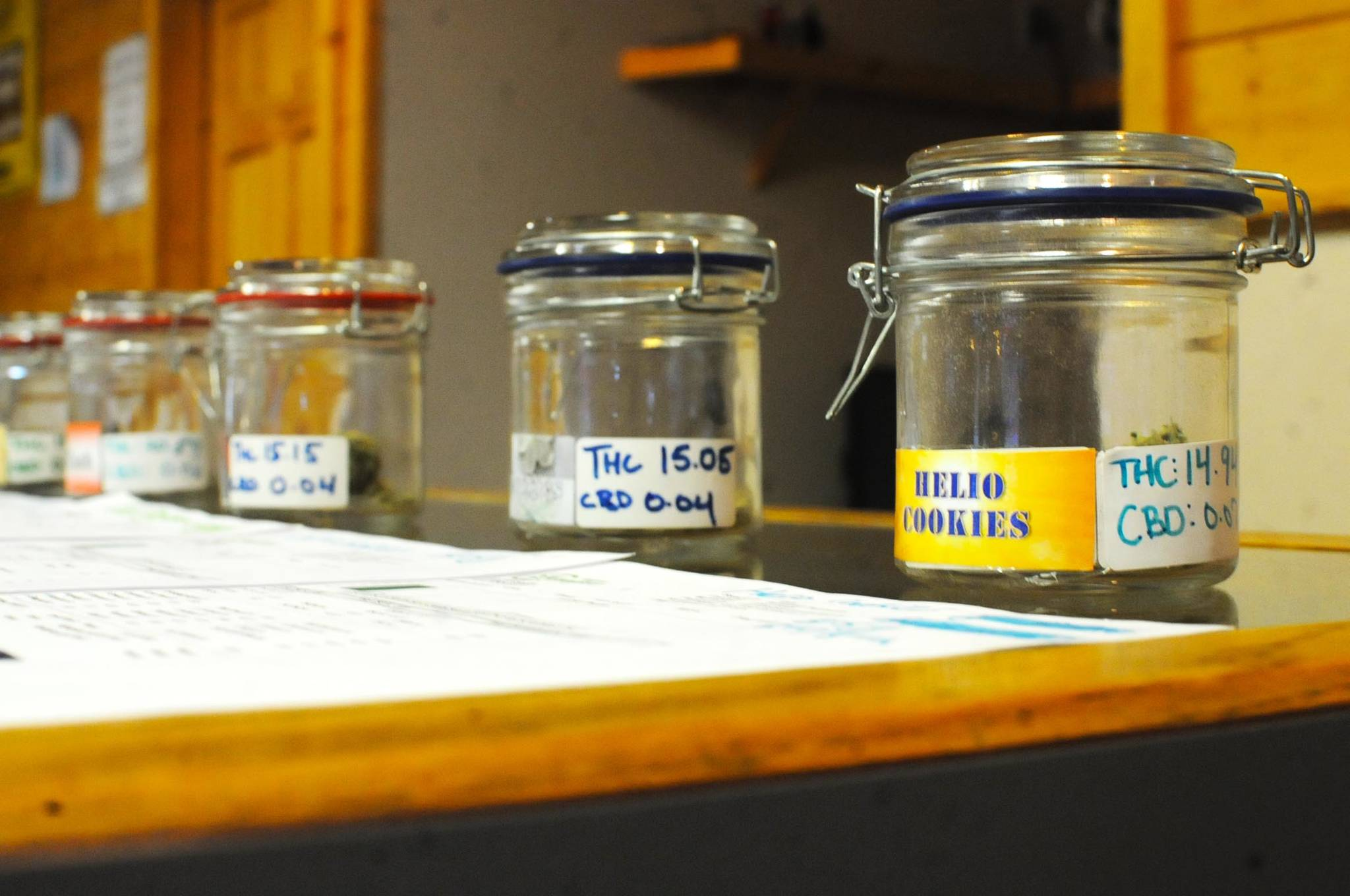 Jars display the various strains of cannabis grown at Permafrost Distributors at the business' Sterling Highway store on Sunday, Dec. 10, 2017 in Sterling, Alaska. The owners opened their Nikiski limited cultivation operation in December 2016 and expanded to the Sterling retail store and cultivation operation in June 2017. (Photo by Elizabeth Earl/Peninsula Clarion)
