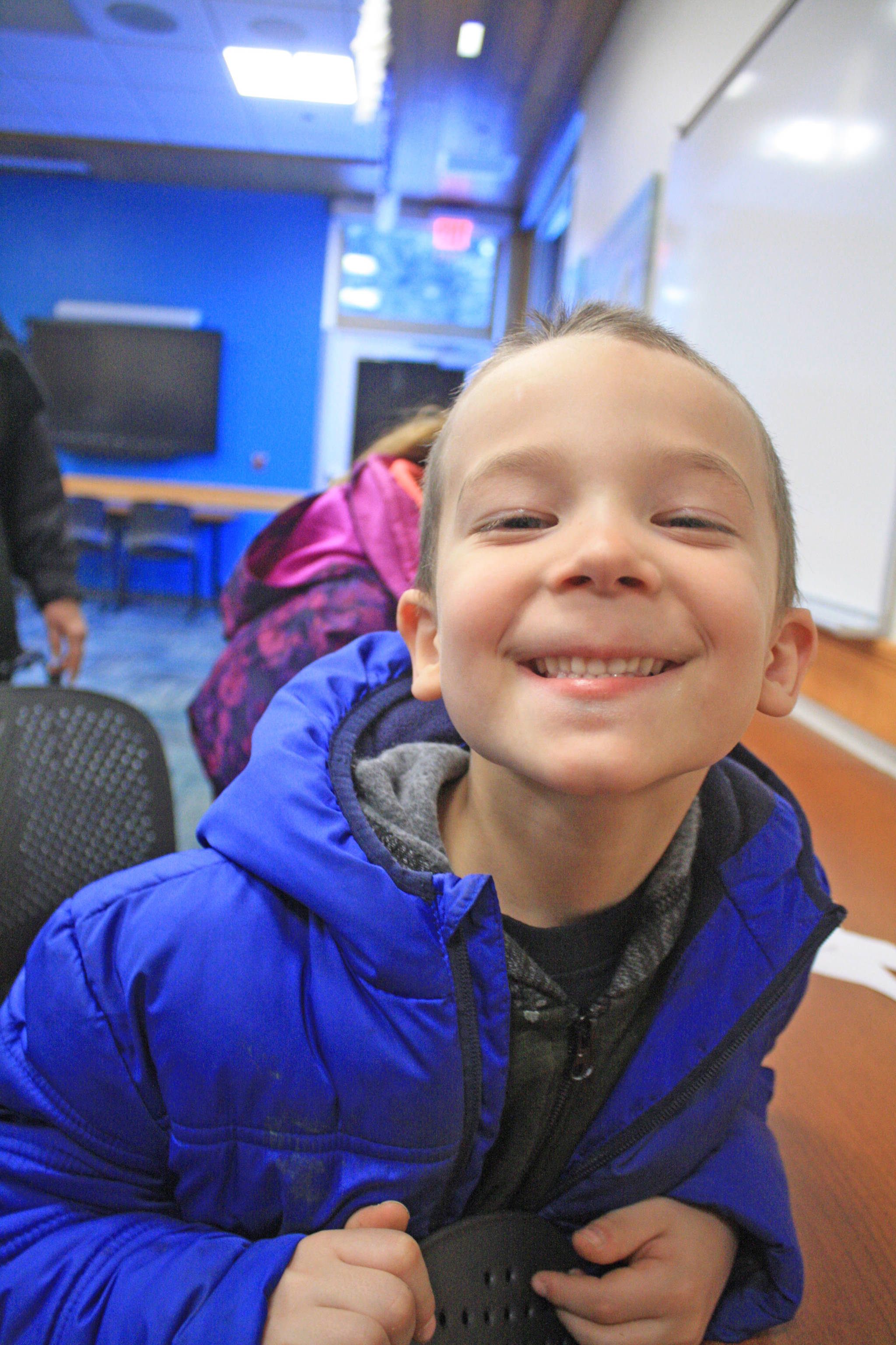 Phillip Larson, 6, takes a break from crafts at the Kenai National Wildlife Refuge Visitor Center on Dec. 27. The visitor center hosted an afternoon of family-friendly activities. (Photo by Erin Thompson/Peninsula Clarion)