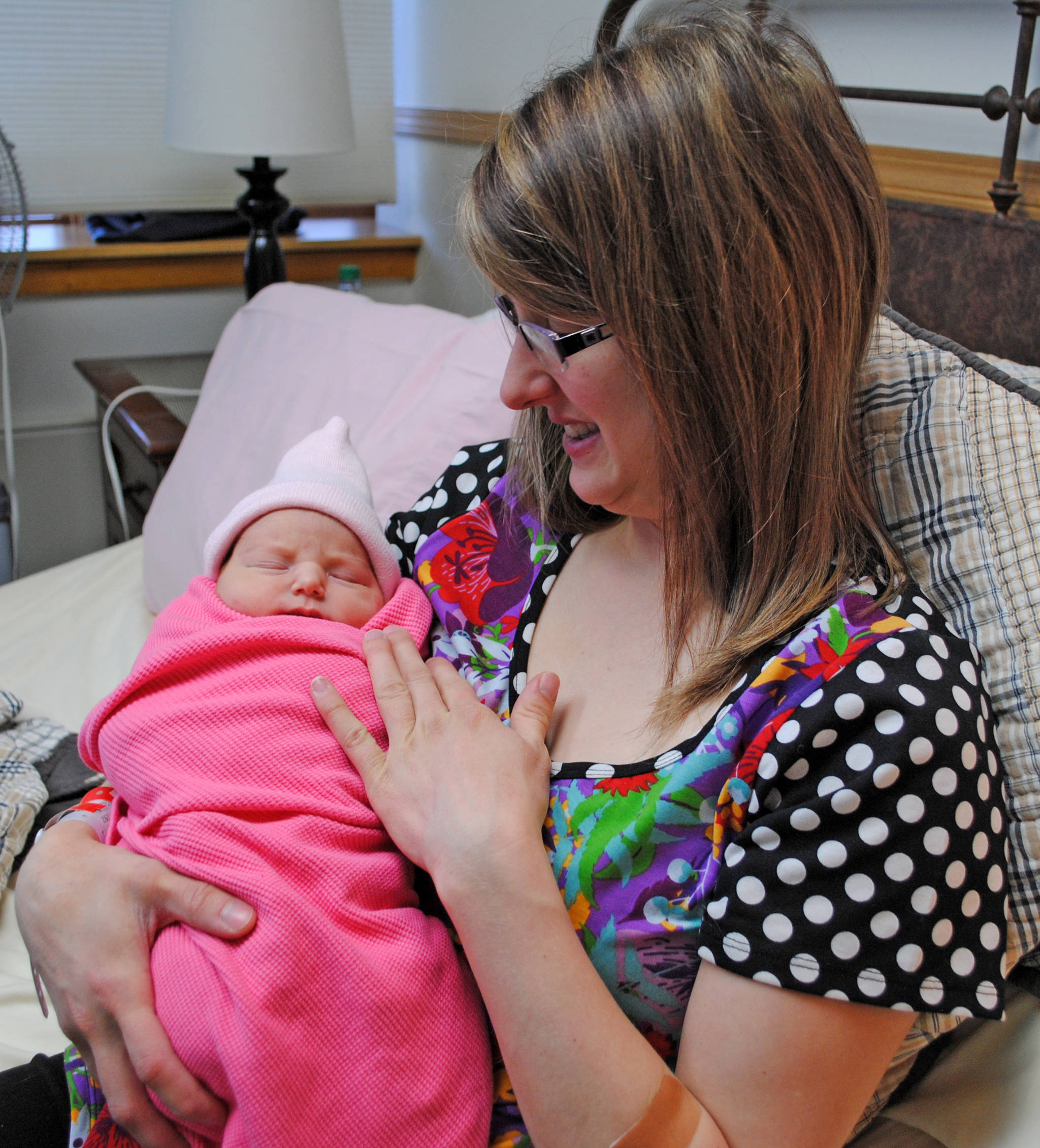Chelsea Samora of Kenai holds her newborn daughter, Zoe, whose Jan. 3 birthday makes her the first baby born in Central Peninsula Hospital in 2018. (Photo by Kat Sorensen/Peninsula Clarion)