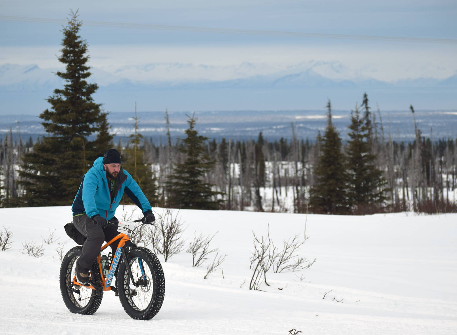 Joel Todd crests a hill during Fat Freddie's Bike Race and Ramble on Saturday, Feb. 10, 2018, in the Caribou Hills. (Photo by Jeff Helminiak/Peninsula Clarion)
