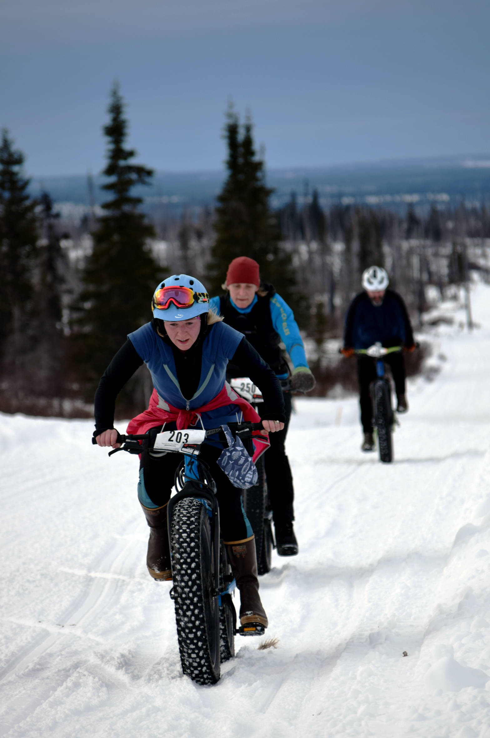 Sara Barrowcliff leads Heidi Isernhagen and Trevor Davis up a hill in the first half of Fat Freddie's Bike Race and Ramble on Saturday, Feb. 10, 2018, in the Caribou Hills. (Photo by Jeff Helminiak/Peninsula Clarion)