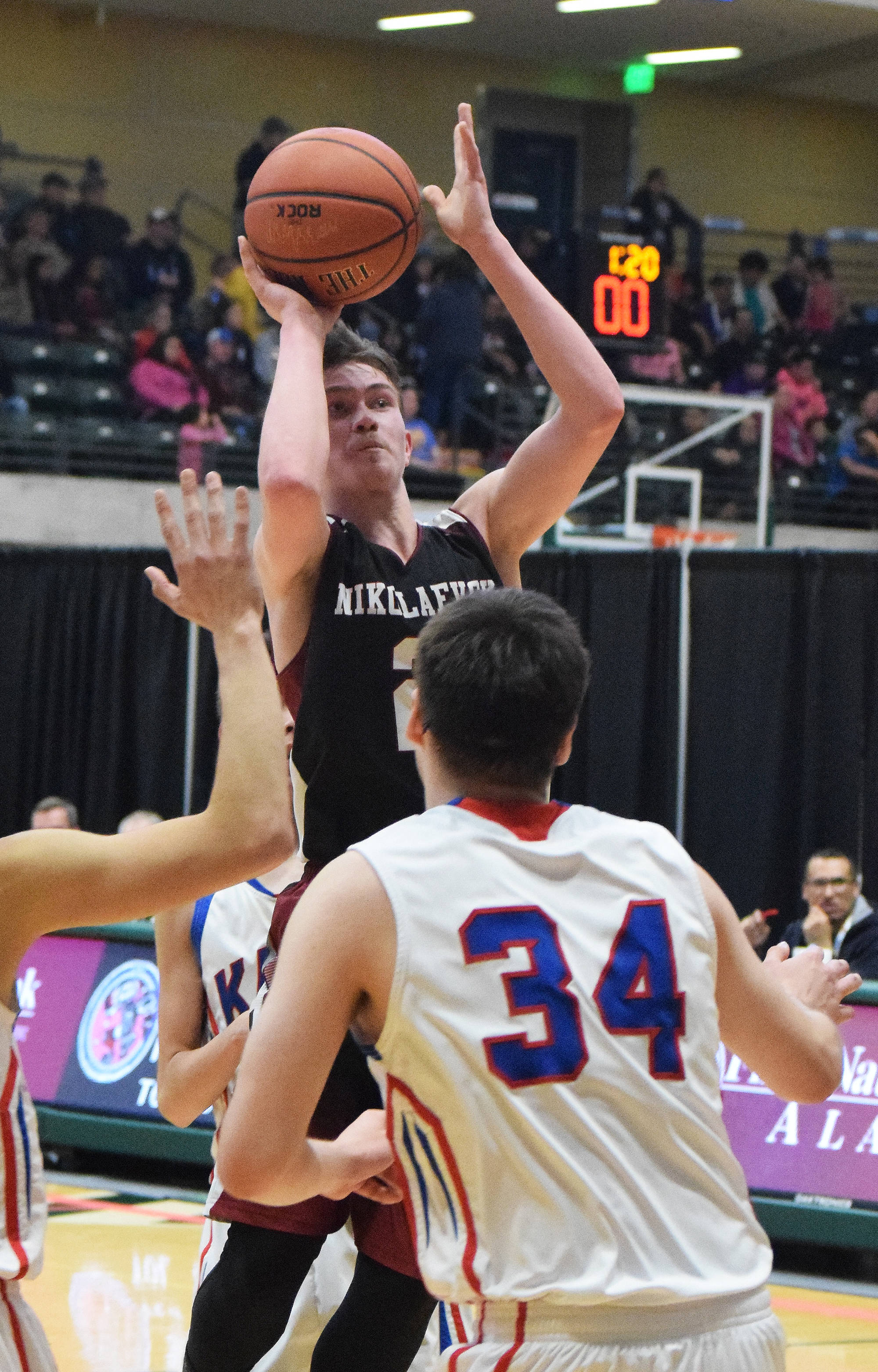 Nikolaevsk's Kalenik Molodih eyes the rim Wednesday against the Kake Thunderbirds at the Class 1A boys state tournament at the Alaska Airlines Center in Anchorage. (Photo by Joey Klecka/Peninsula Clarion)
