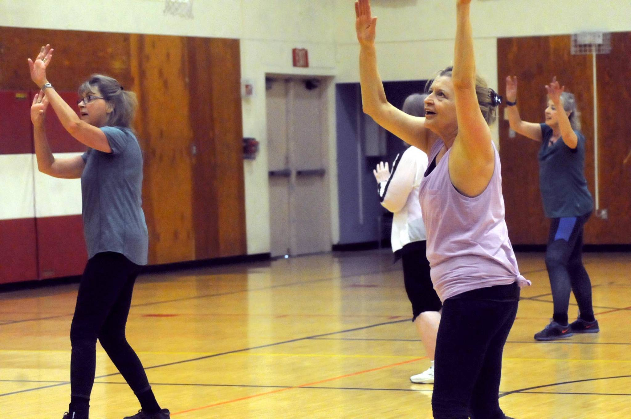 sallie macy right and bobbie baldwin left dance during truman krogels zumba gold class at the kenai recreation center on thursday march 15