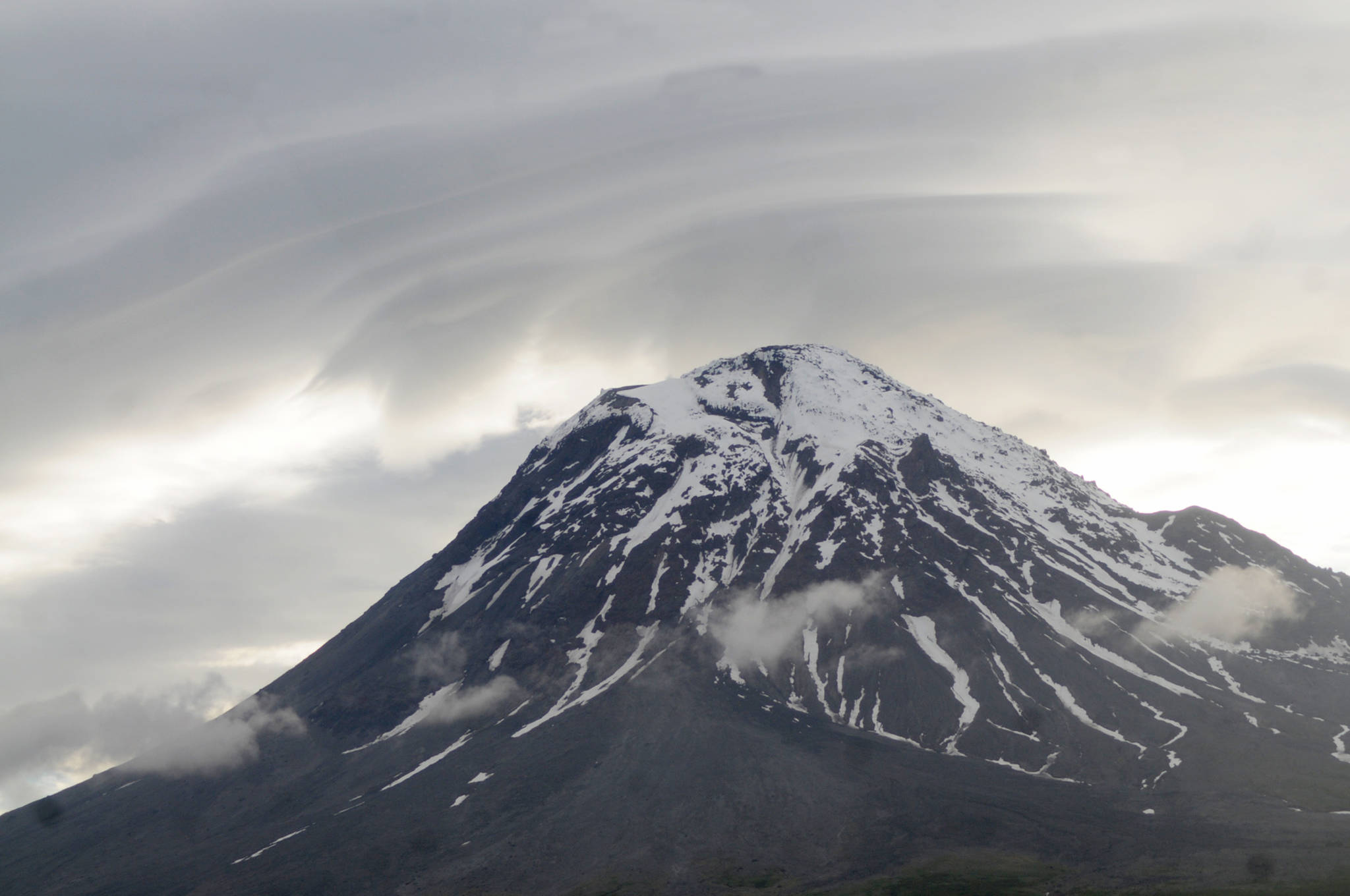 Clouds and smoke curl around the top of Augustine Volcano on Sunday, June 4, 2017 on Augustine Island, Alaska. The remote island in Cook Inlet is composed of little more than the volcano and its surrounding debris. (Elizabeth Earl/Peninsula Clarion)