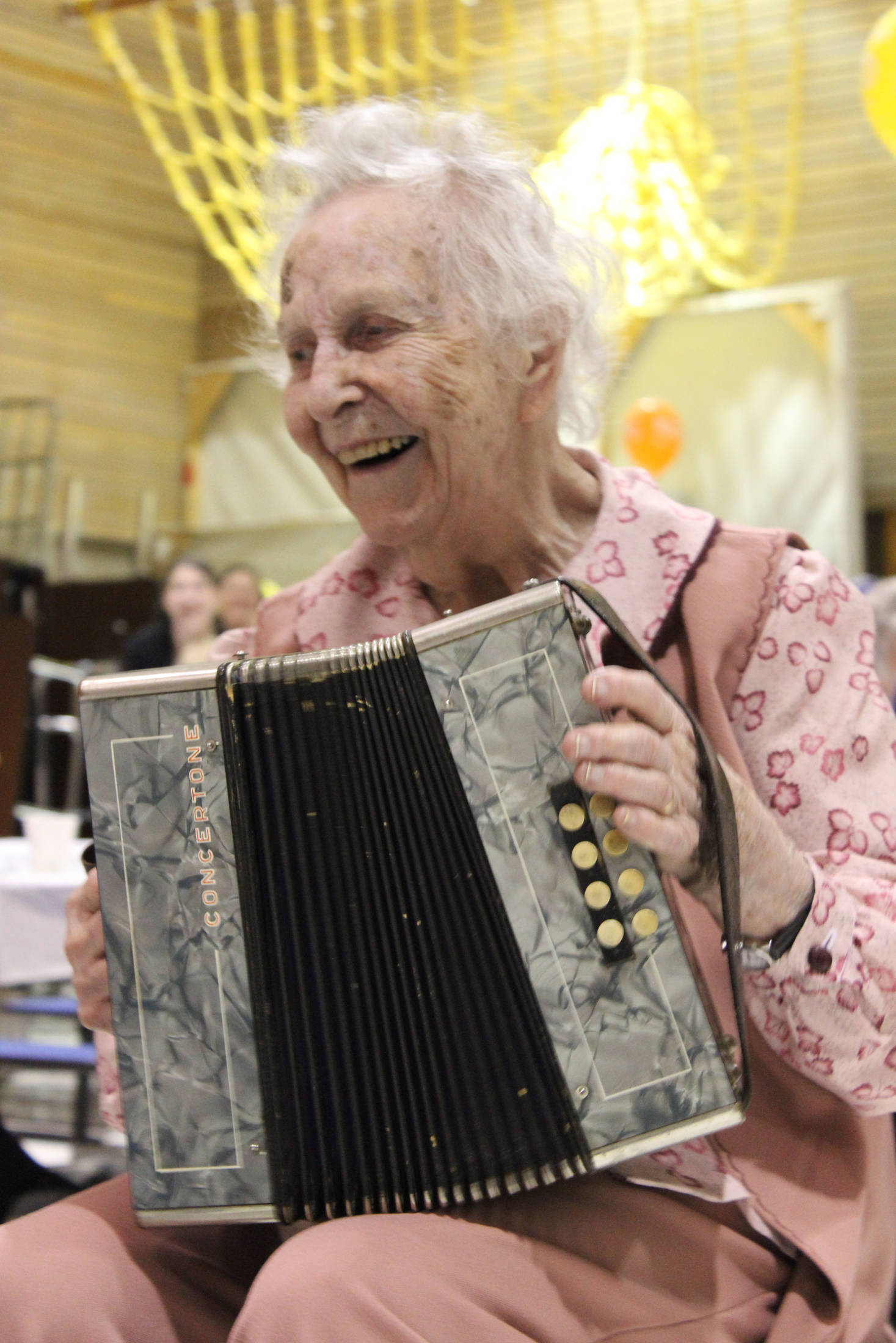 """Wilma Gregory celebrates her 100th birthday Saturday by serenading family and friends to """"Mockingbird Hill"""" played on her accordion. The celebration was held at McNeil Canyon School. (Photo by McKibben Jackinsky)"""
