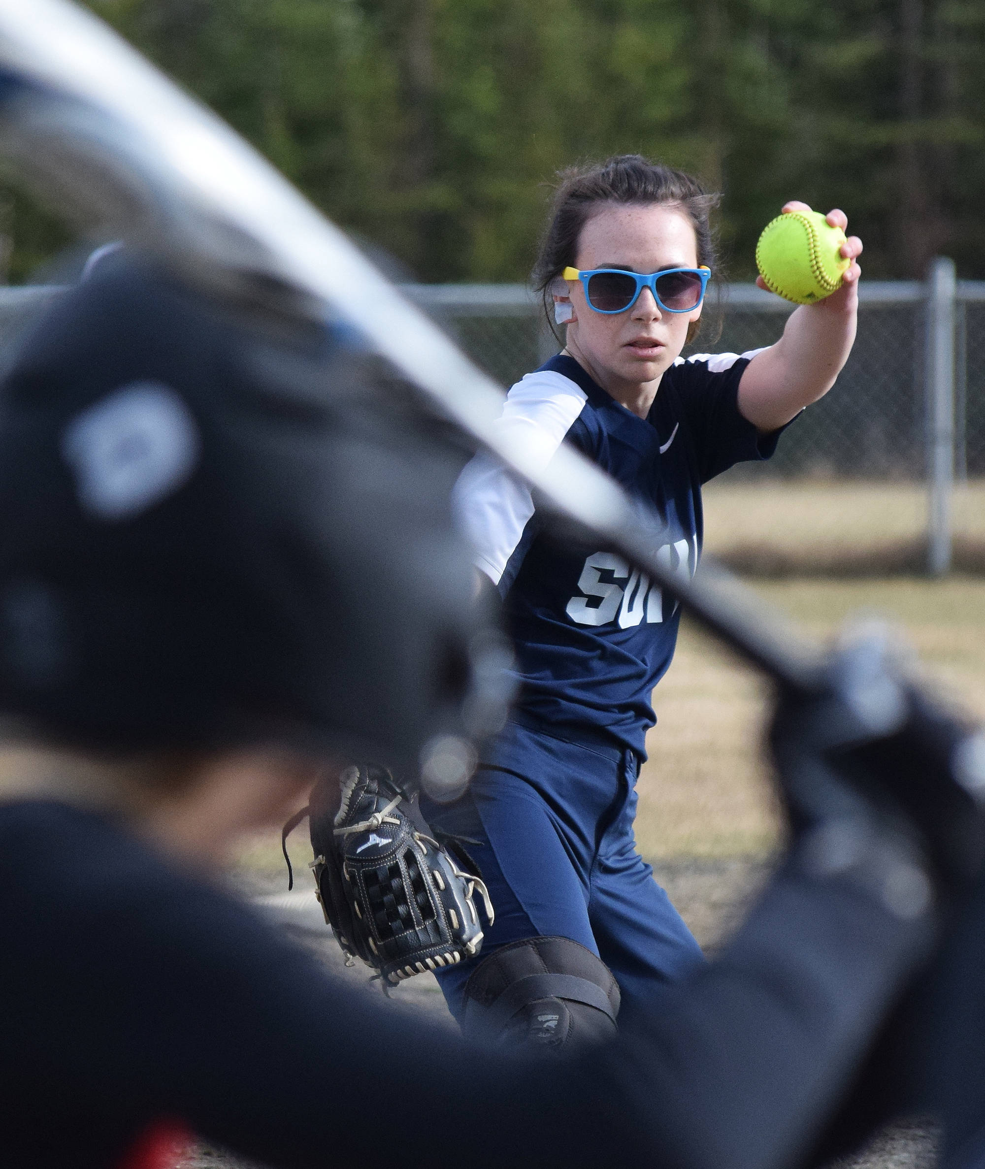 Soldotna senior Taralynn Frates offers up a pitch to a Kenai Central batter Friday in a Northern Lights Conference contest at the Soldotna softball fields. (Photo by Joey Klecka/Peninsula Clarion)