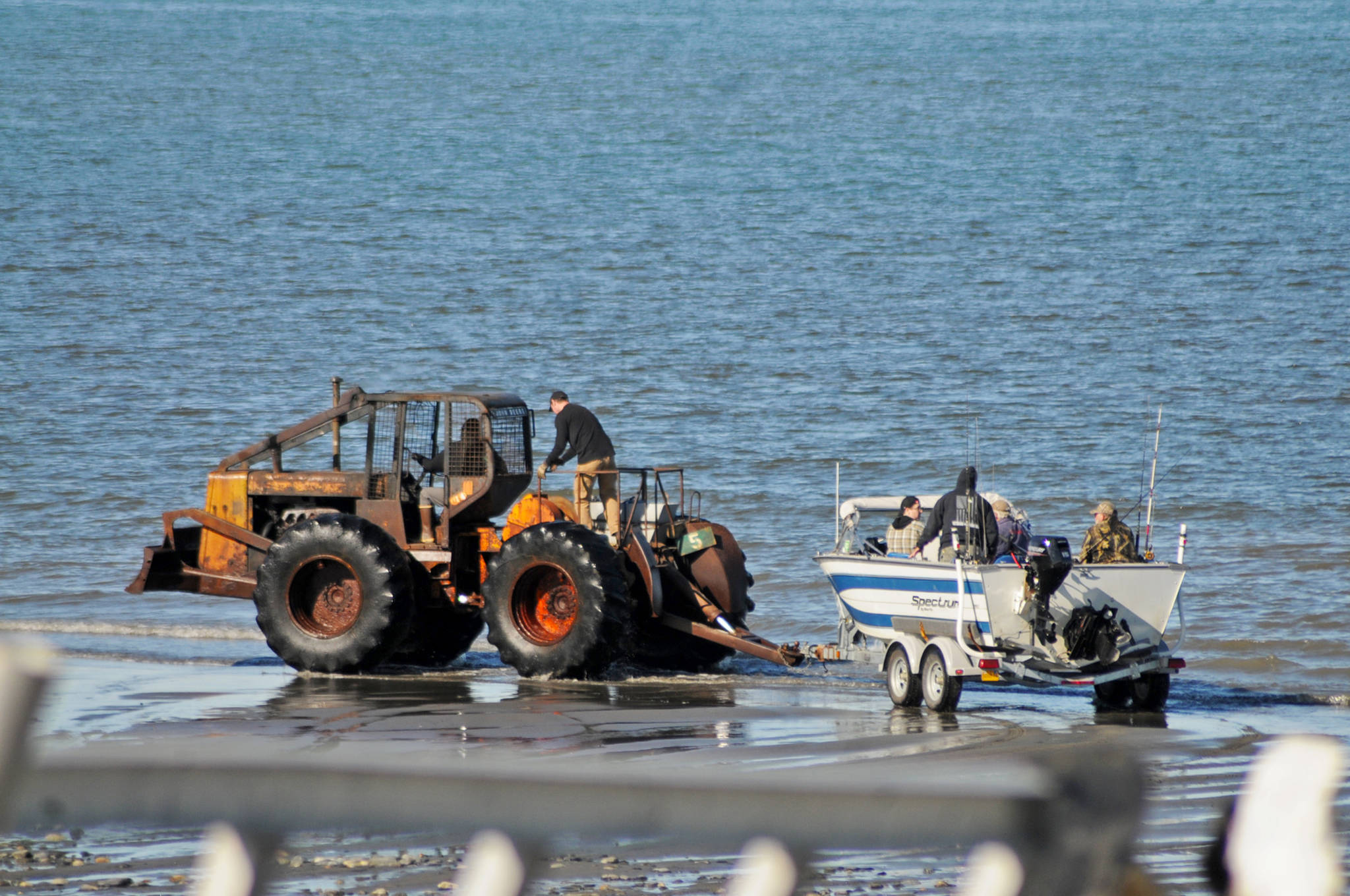 Anglers prepare to head out onto Cook Inlet from the tractor launch at Deep Creek State Recreation Site on Sunday, May 28, 2018 in Ninilchik, Alaska. Halibut fishing has been reportedly fair so far this year, with anglers regularly landing halibut smaller than 100 pounds and a few over 100 pounds out of Ninilchik. (Photo by Elizabeth Earl/Peninsula Clarion)
