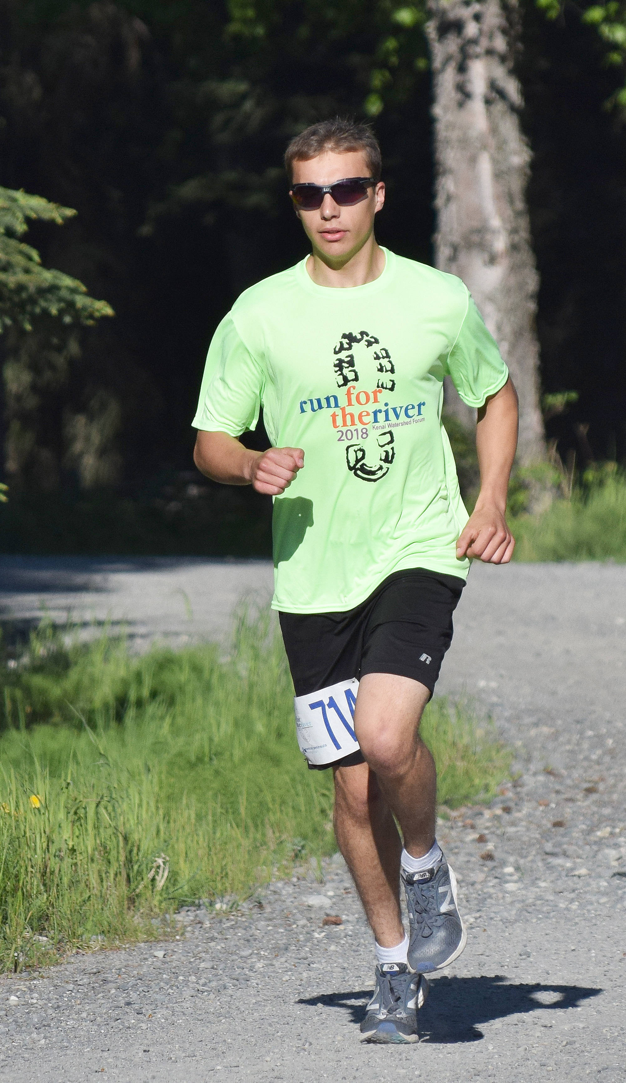Bradley Walters takes an early lead Saturday morning at the Run for the River 5K/10-mile races near Soldotna Creek Park. (Photo by Joey Klecka/Peninsula Clarion)