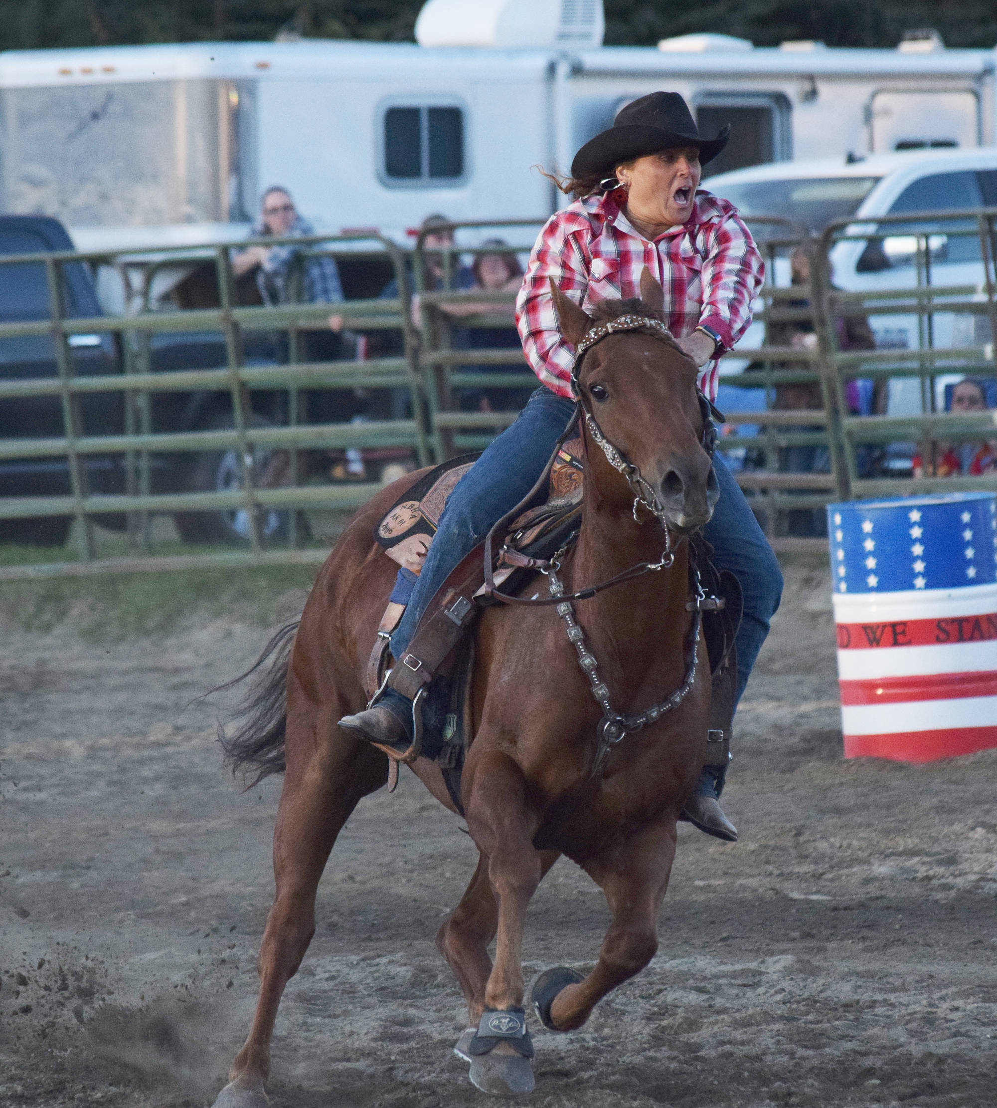 Cassie McKenzie completes a barrel racing circuit Saturday at the 9/11 Tribute Rodeo at the Soldotna Rodeo Grounds. (Photo by Joey Klecka/Peninsula Clarion)