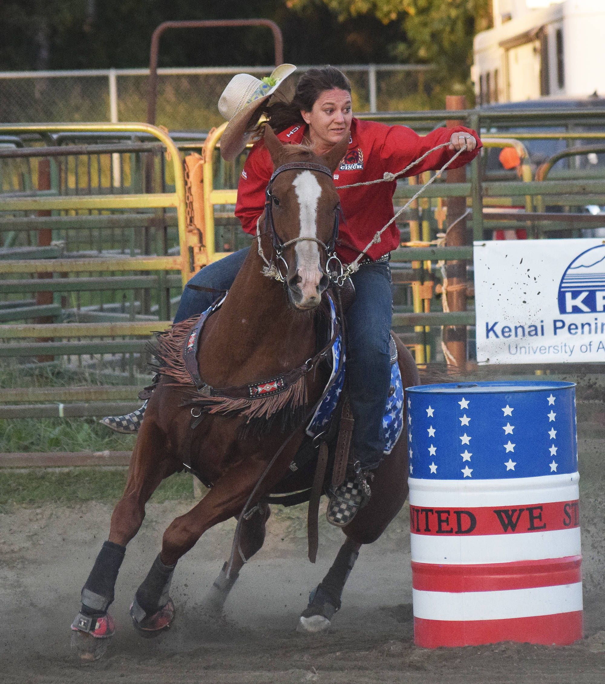 A rider and her horse round a barrel Saturday, Sept. 8 at the 9/11 Tribute Rodeo at the Soldotna Rodeo Grounds in Soldotna, Alaska. (Photo by Joey Klecka/Peninsula Clarion)