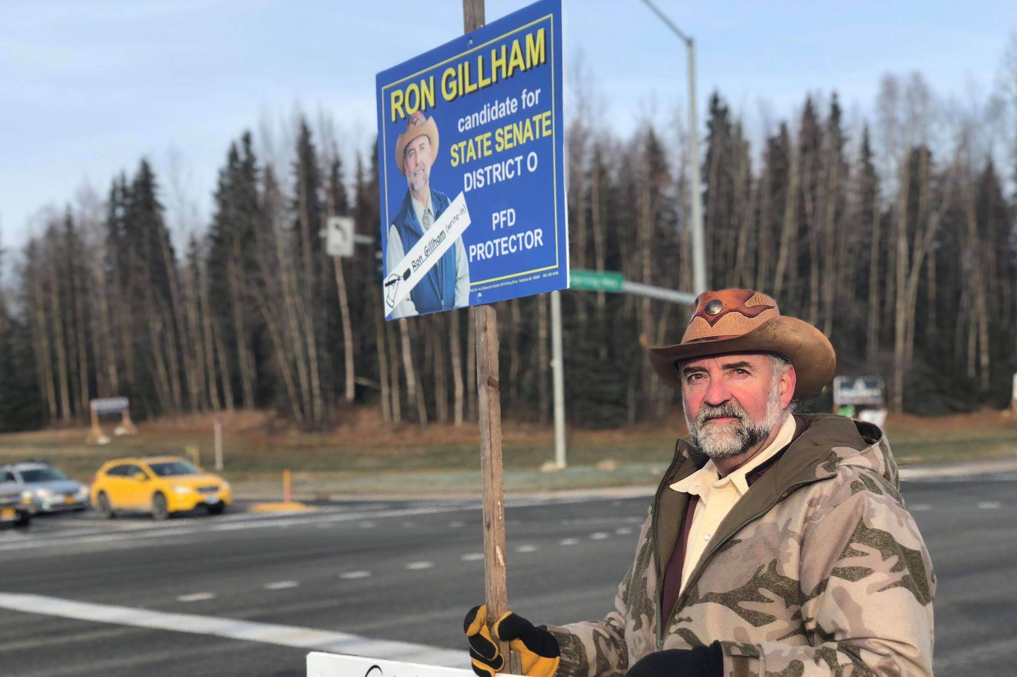 District O State Senate candidate Ron Gilliam holds a sign at the intersection of the Sterling and Kenai Spur Highways on Tuesday, Nov. 6, 2018, in Soldotna, Alaska. (Photo by Victoria Petersen/Peninsula Clarion)