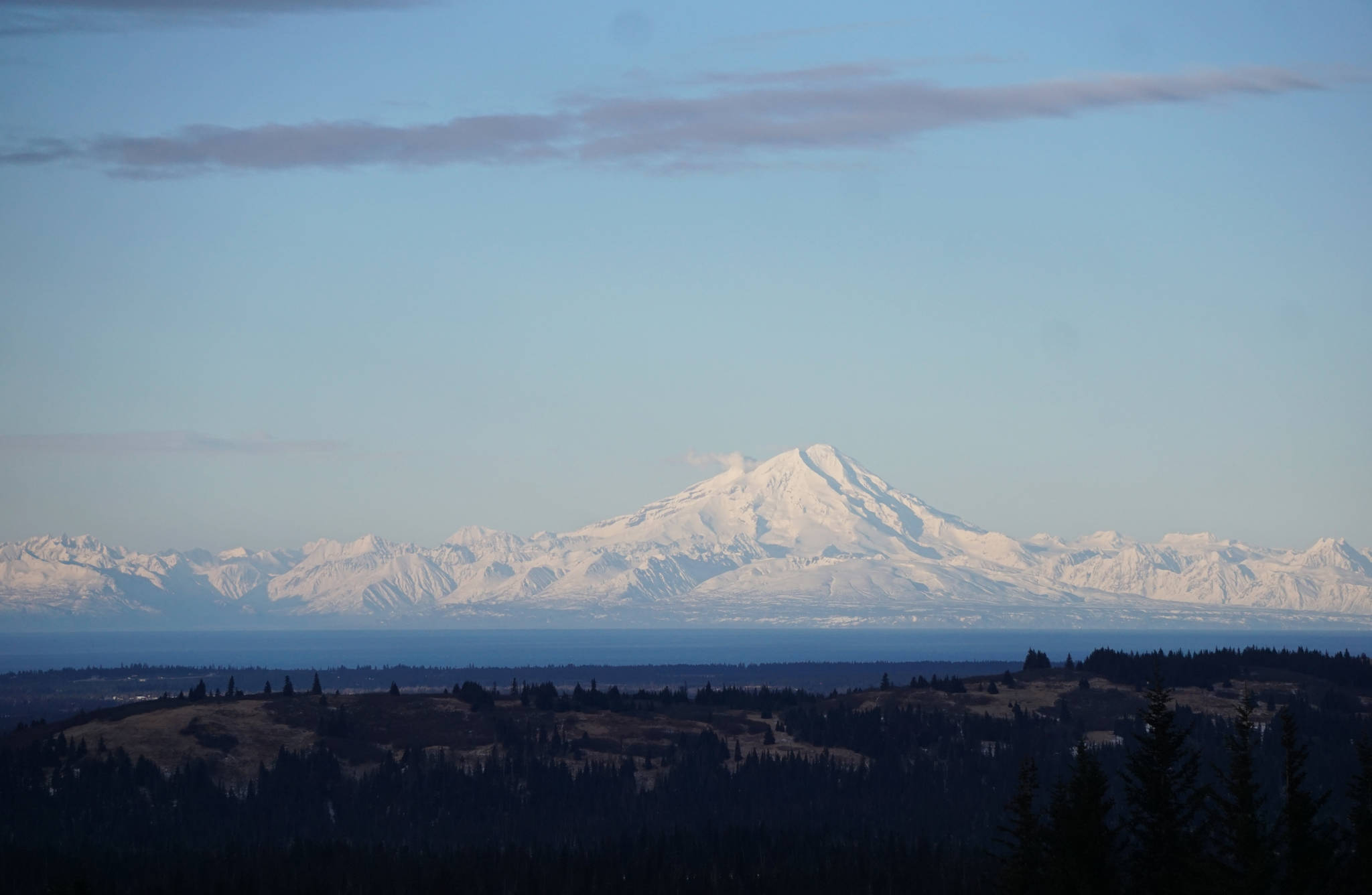 Steam rises from Redoubt Volcano on Sunday afternoon, Jan. 21, as seed from Diamond Ridge. (Photo by Michael Armstrong, Homer News)