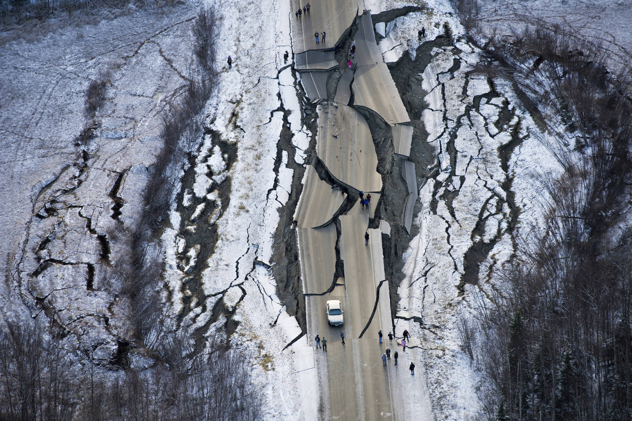 This aerial photo shows damage on Vine Road, south of Wasilla, Alaska, after earthquakes Friday, Nov. 30, 2018. Back-to-back earthquakes measuring 7.0 and 5.7 shattered highways and rocked buildings Friday in Anchorage and the surrounding area, sending people running into the streets and briefly triggering a tsunami warning for islands and coastal areas south of the city. (Marc Lester/Anchorage Daily News via AP)                                 This aerial photo shows damage on Vine Road, south of Wasilla, Alaska, after earthquakes Friday, Nov. 30, 2018. Back-to-back earthquakes measuring 7.0 and 5.7 shattered highways and rocked buildings Friday in Anchorage and the surrounding area, sending people running into the streets and briefly triggering a tsunami warning for islands and coastal areas south of the city. (Marc Lester/Anchorage Daily News via AP)