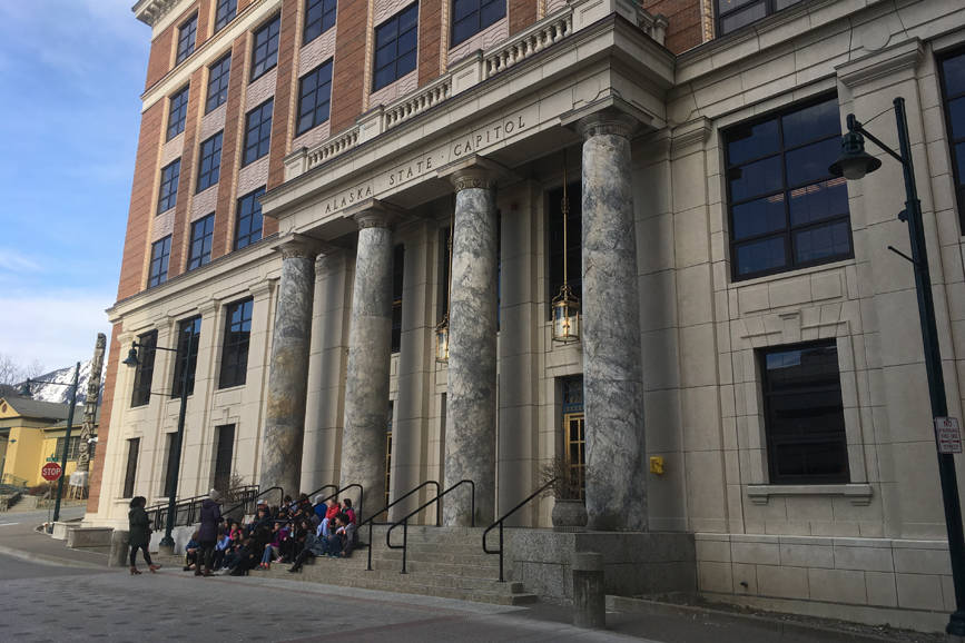 Students sit on the front steps of the Alaska Capitol on April 6, 2018. (James Brooks photo   Juneau Empire)