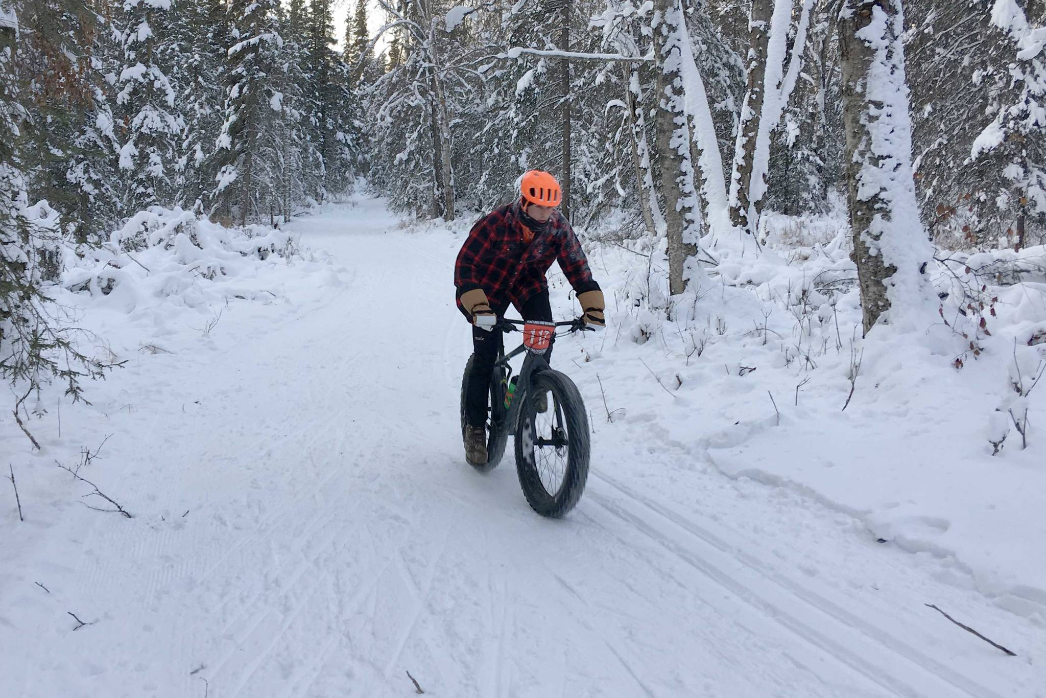 Tyle Owens rides to victory Sunday, Dec. 23, 2018, in Freezer Food Series Race 5, a six-mile fat bike race at the Slikok Trails outside of Soldotna. (Photo by Jeff Helminiak/Peninsula Clarion)