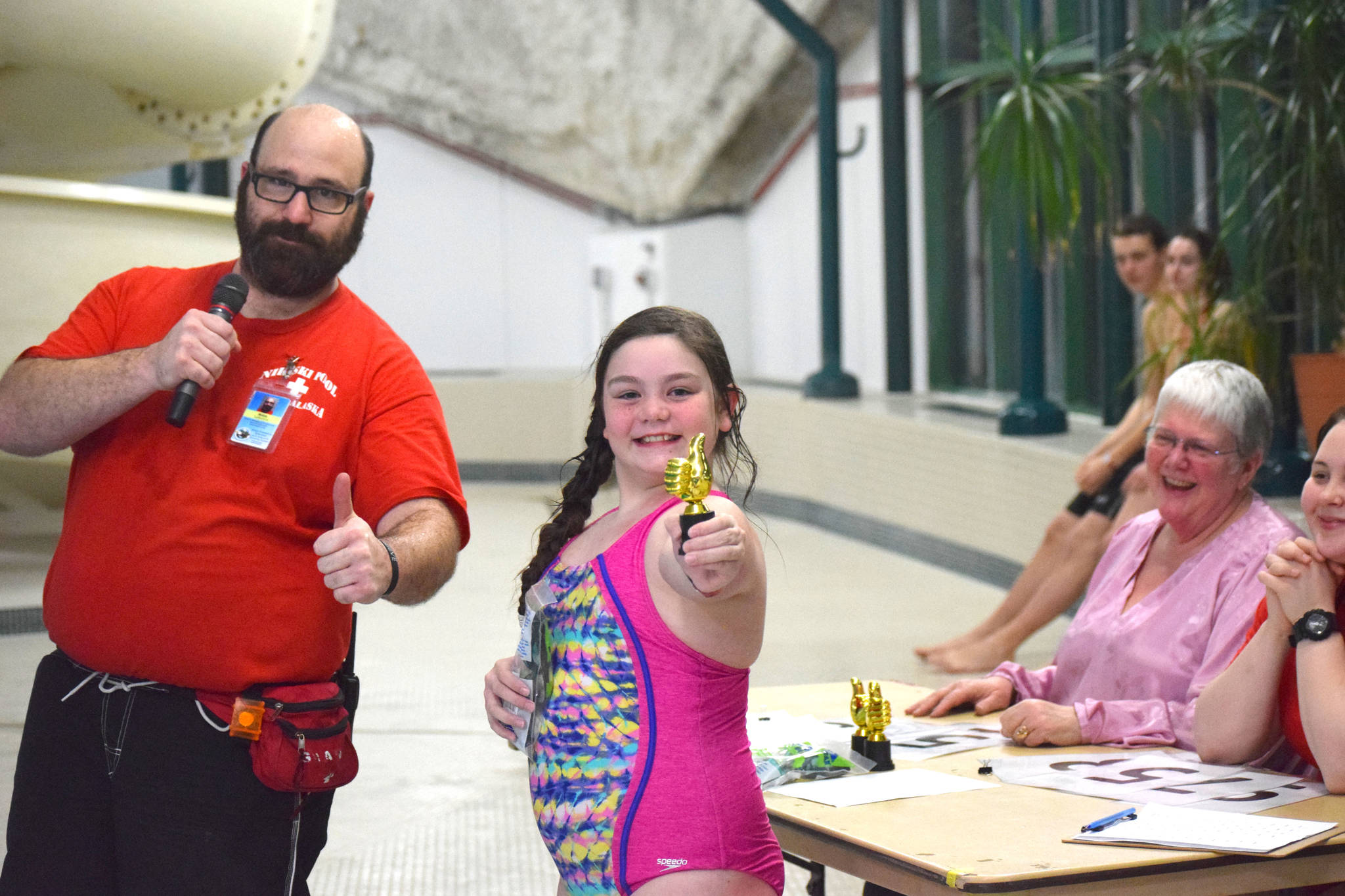 One of the winners of the cannonball contest at the Nikiski Pool poses with her trophy on Thursday, Jan. 17, 2019. (Photo by Brian Mazurek/Peninsula Clarion)