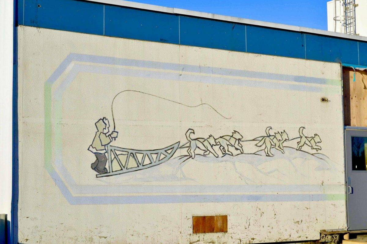After construction workers removed siding from the facade of the Kenai Municipal Airport, a mural with iconic Kenai images like fishing nets, the St. Nicholas Russian Orthodox chapel and a dog musher, was revealed on Tuesday, Jan. 15, 2019 in Kenai, Alaska.(Photo by Victoria Petersen/Peninsula Clarion)