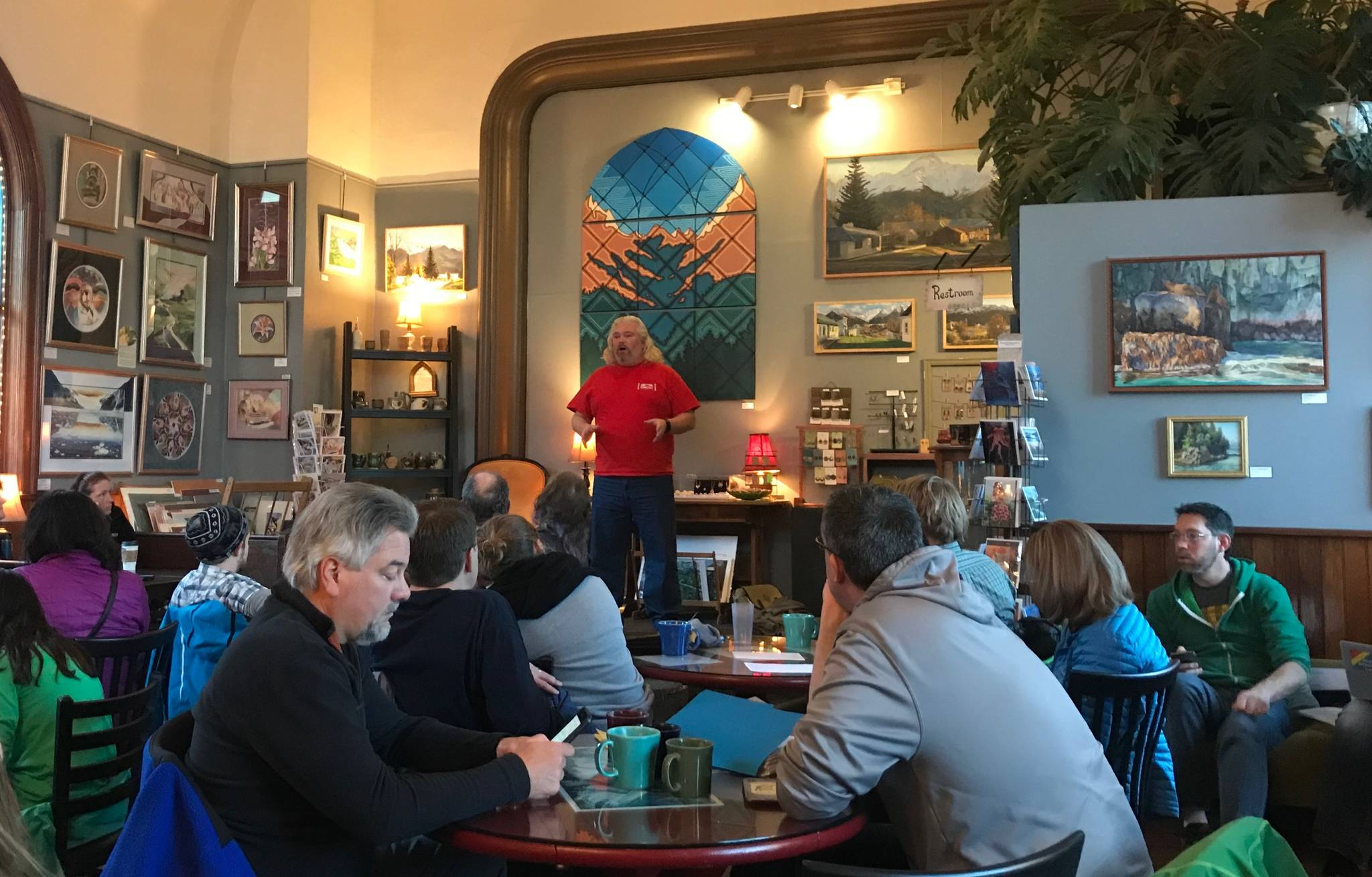 KPEA President David Brighton speaks to a group of educators, community members and district employees at Resurrect Art Coffee House on Friday, in Seward. (Photo by Kat Sorensen/Peninsula Clarion)