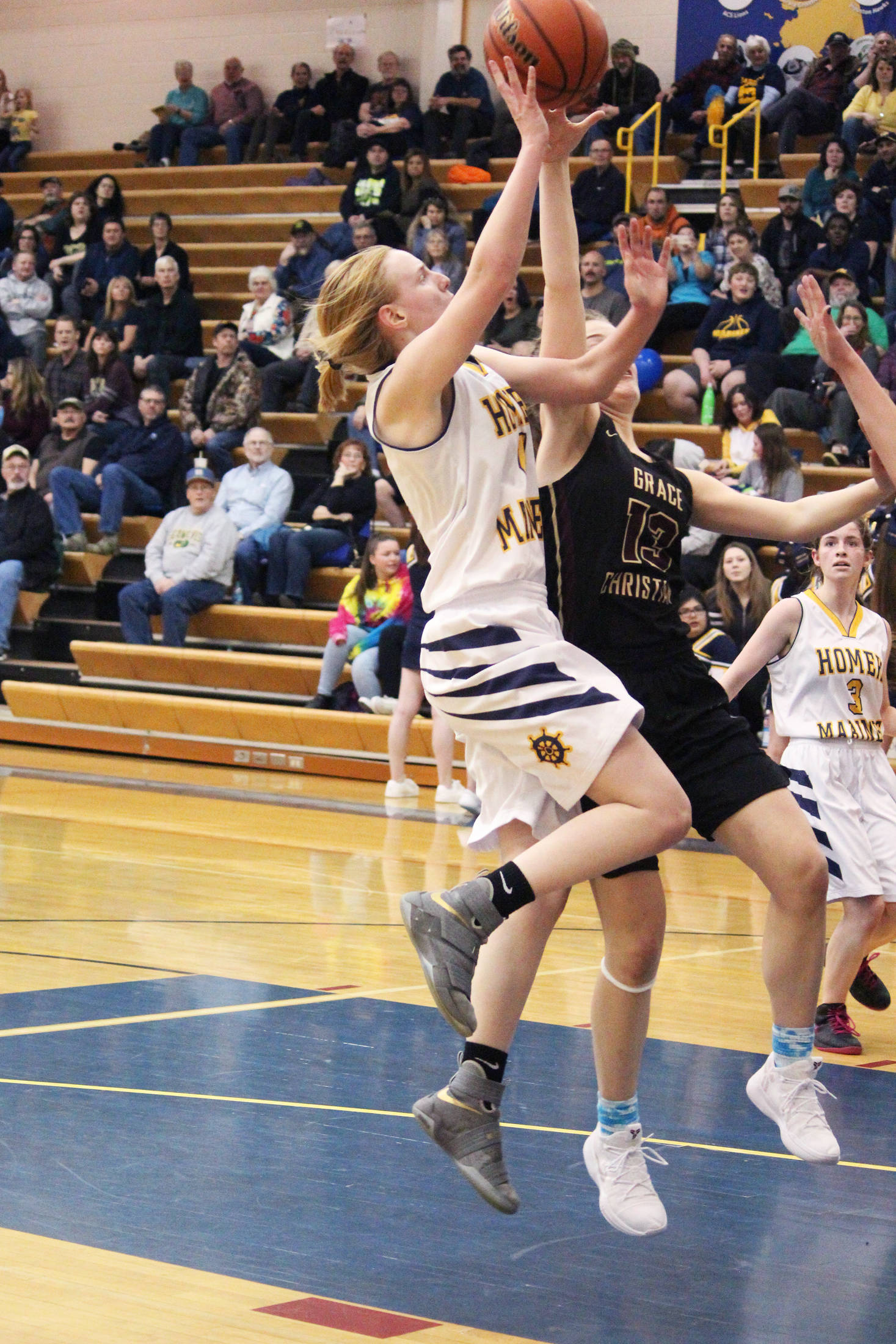 Homer's Kelli Bishop takes a shot on the Grace Christian School basket during a Friday, Feb. 22, 2019 game in Homer, Alaska. Grace is one of three private school teams in Region 3A basketball. (Photo by Megan Pacer/Homer News)