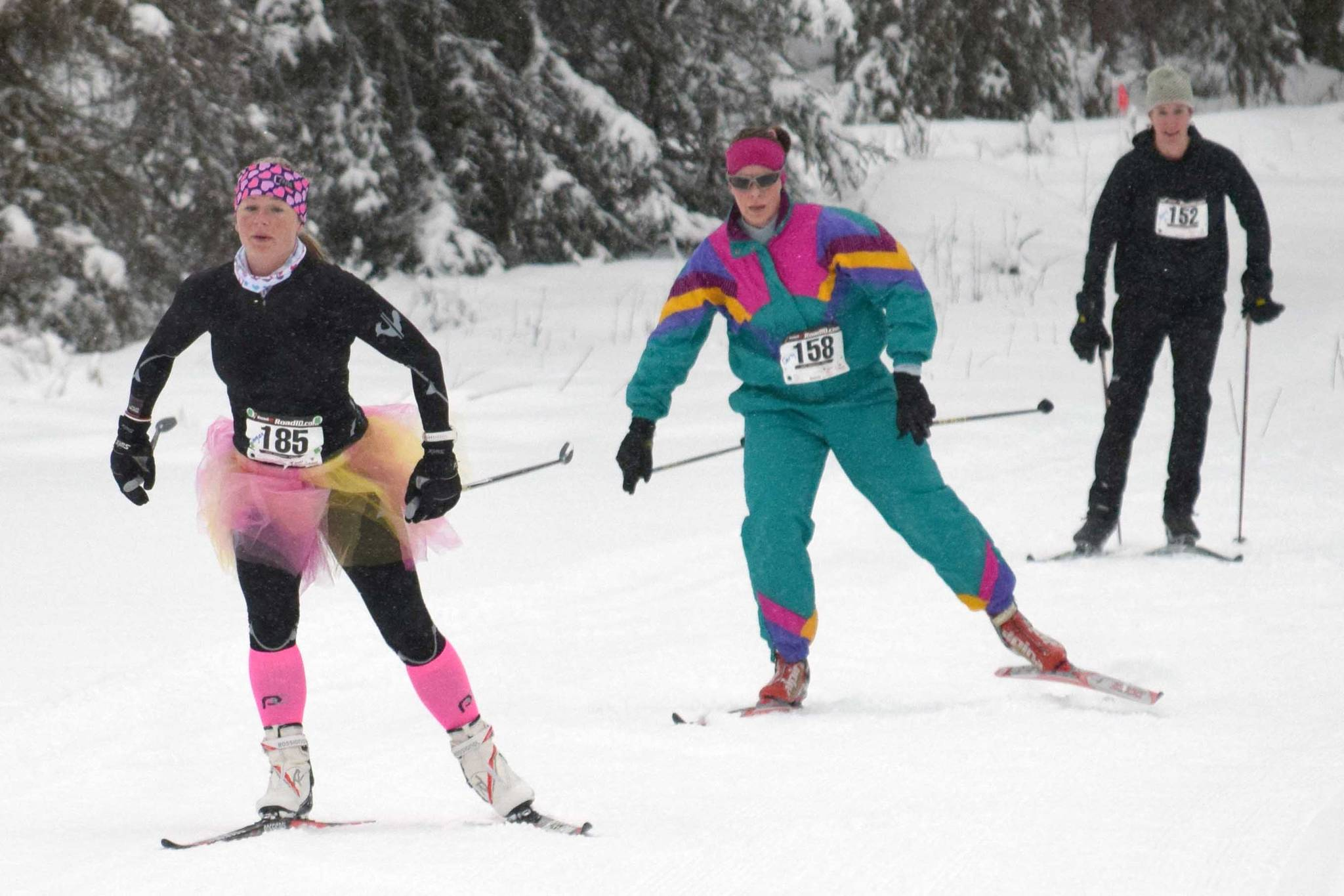 Eventual race winner Morgan Aldridge leads Carly Reimer and Amy Anderson at the Ski for Women on Sunday, Feb. 3, 2019, at Tsalteshi Trails. (Photo by Jeff Helminiak/Peninsula Clarion)