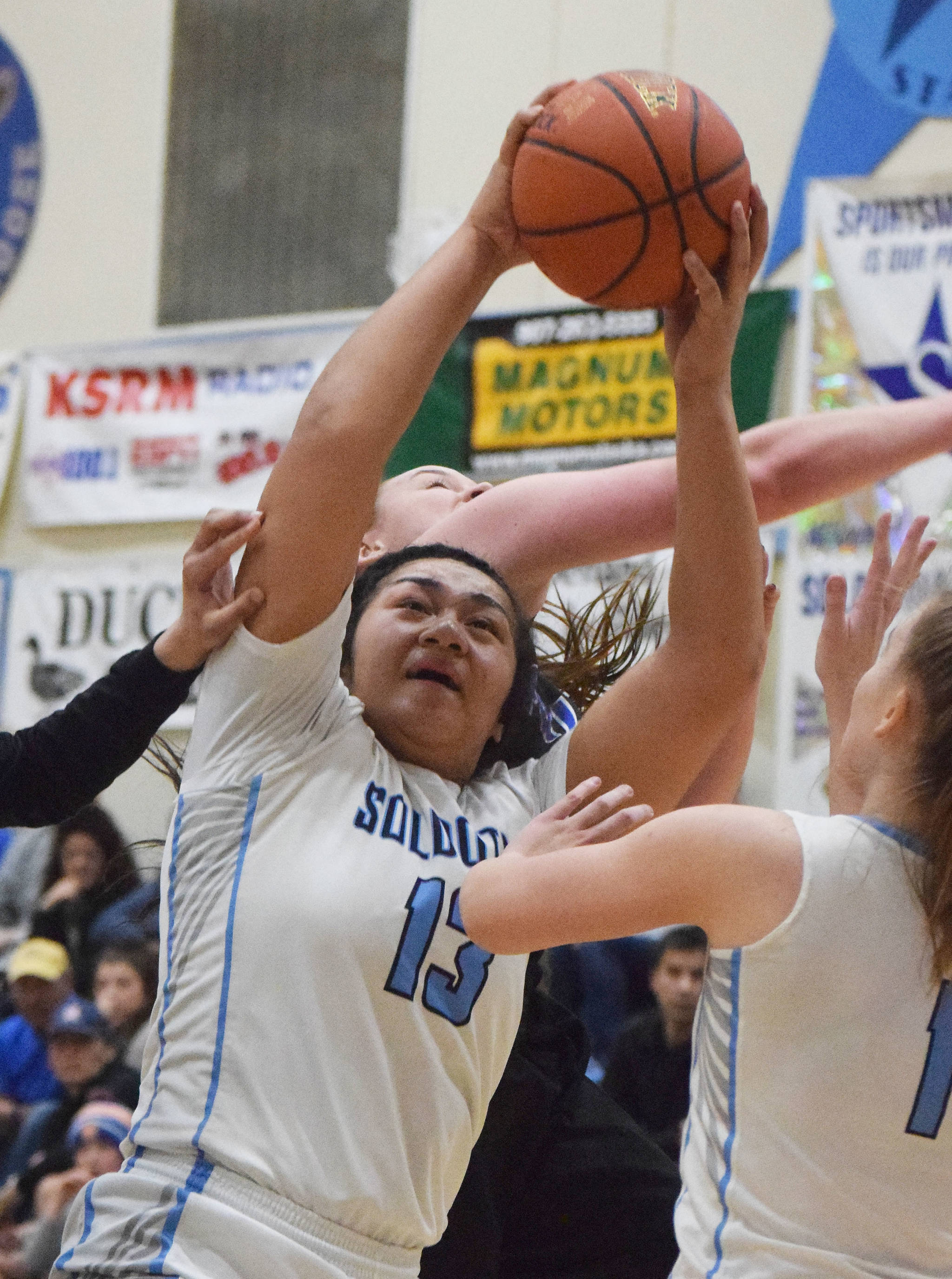 Soldotna's Ituau Tuisaula (13) grabs a rebound Friday night in the Northern Lights Conference semifinals against Palmer at Soldotna High School. (Photo by Joey Klecka/Peninsula Clarion)