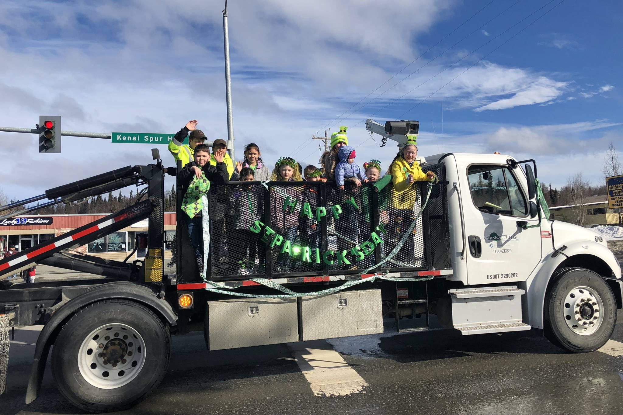 Residents in the parade wave to passerbys at the 28th annual Soldotna St. Patrick's Day Parade on March, 17, 2019, in Soldotna, Alaska. (Photo by Victoria Petersen/Peninsula Clarion)