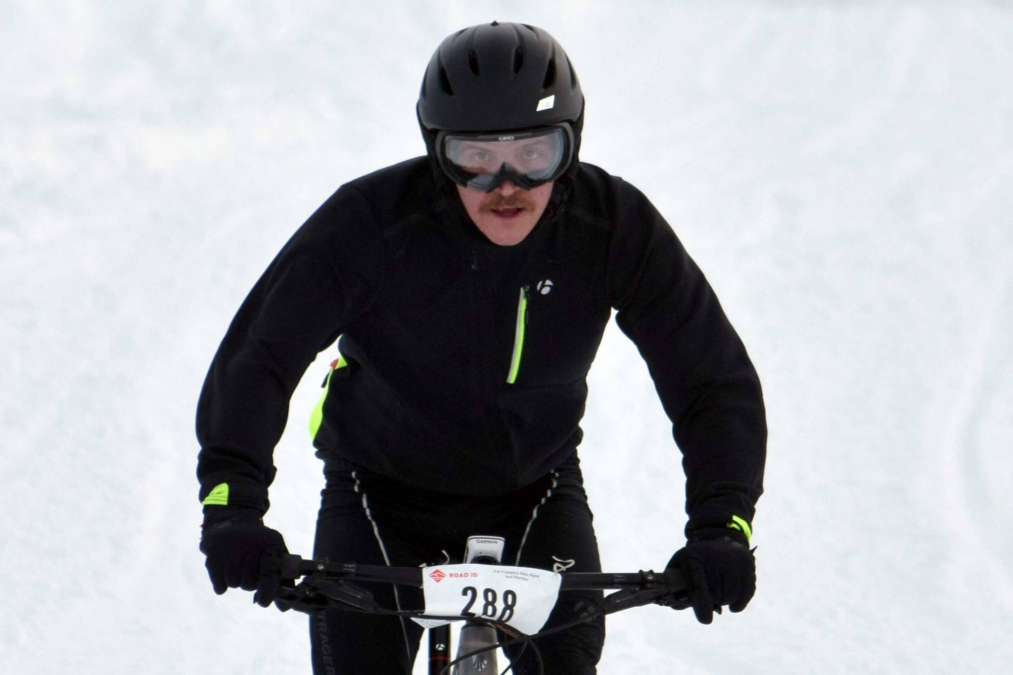 Mike Crawford barrels down a hill during Fat Freddie's Bike Race and Ramble on Saturday, Feb. 9, 2019, in the Caribou Hills near Freddie's Roadhouse. (Photo by Jeff Helminiak/Peninsula Clarion)                                 Mike Crawford barrels down a hill during Fat Freddie's Bike Race and Ramble on Saturday, Feb. 9, 2019, in the Caribou Hills near Freddie's Roadhouse. (Photo by Jeff Helminiak/Peninsula Clarion)