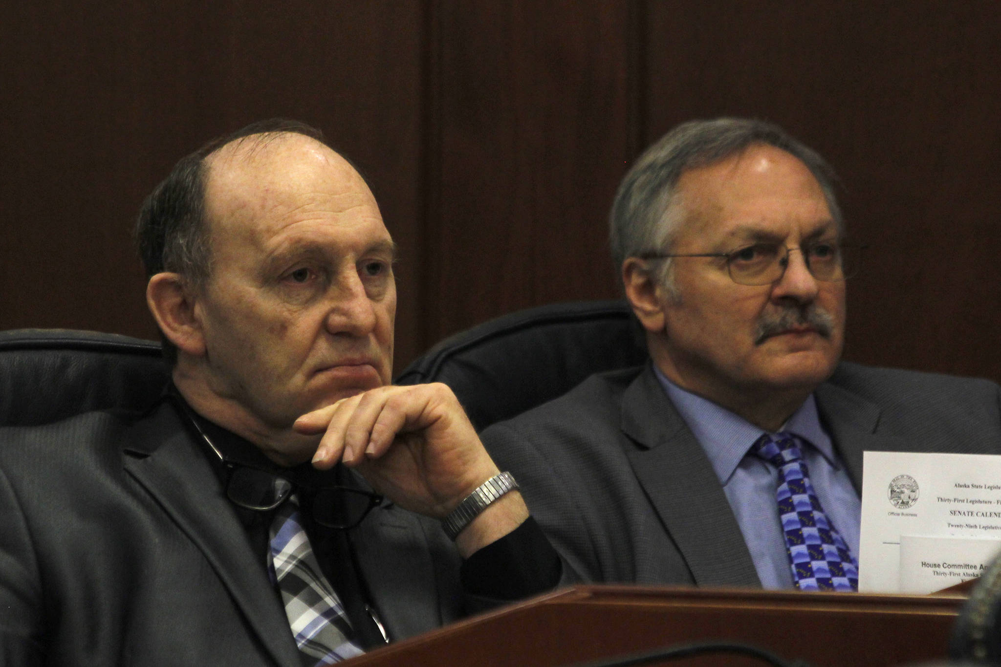 Rep. Gary Knopp, R-Kenai, and Rep. Dave Talerico, R-Healy, sit next to each other after Knopp voted not to confirm Talerico as Speaker of the House on Tuesday. (Alex McCarthy | Juneau Empire)