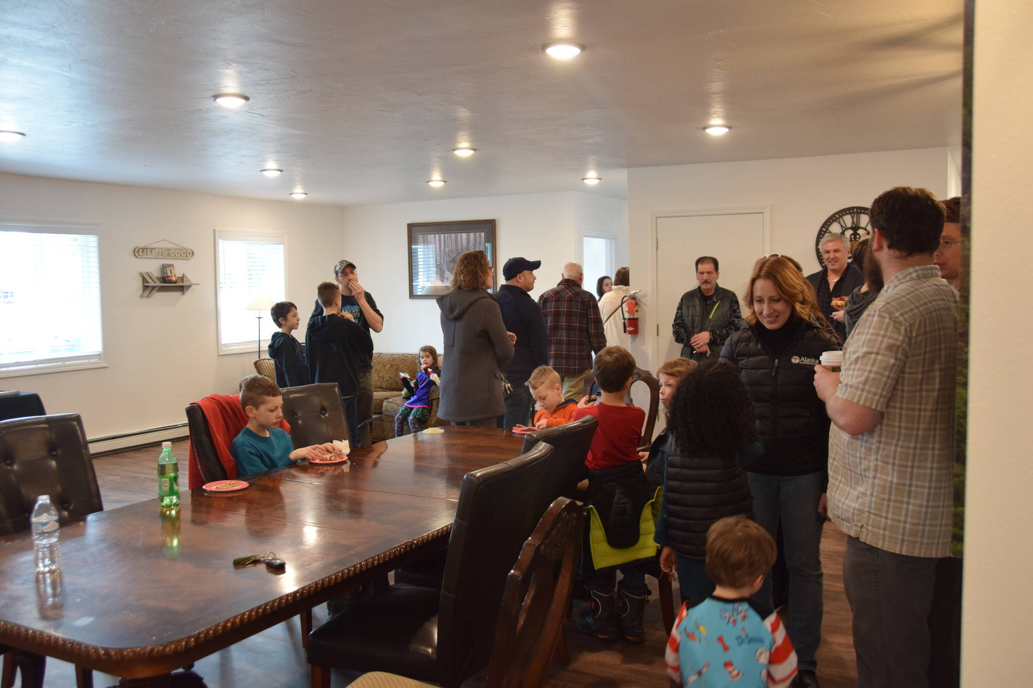 Community members show their support for the opening of Freedom House's men's residence in Soldotna, Alaska, on March 24, 2019. (Photo by Brian Mazurek/Peninsula Clarion)