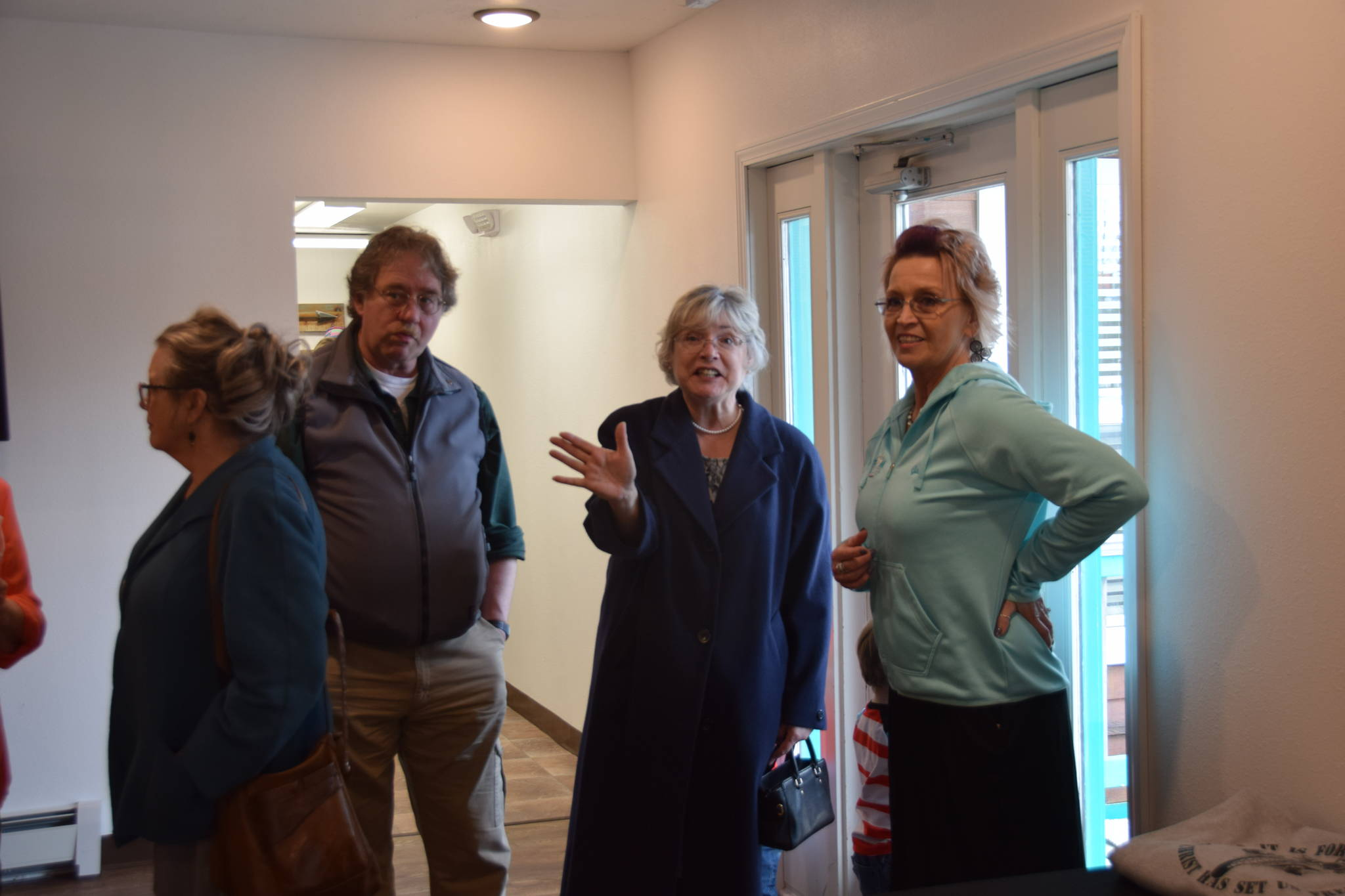 Gail Kennedy of Freedom House, right, speaks with members of the community during the opening of Freedom House's men's residence in Soldotna, Alaska, on March 24, 2019. (Photo by Brian Mazurek/Peninsula Clarion)