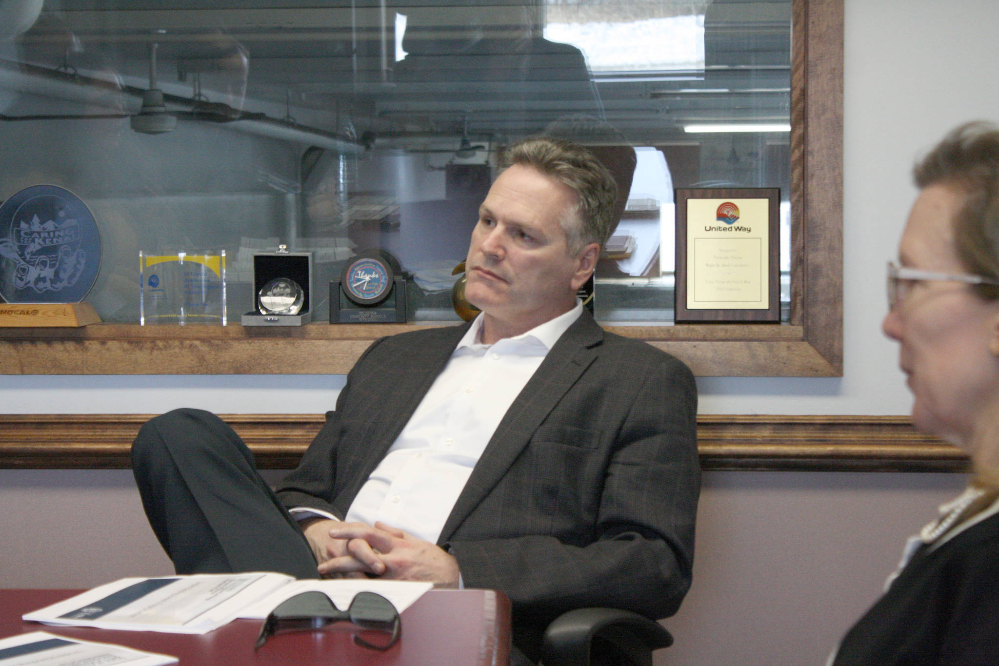 Gov. Mike Dunleavy, center, speaks about education with Clarion reporters Brian Mazurek and Victoria Petersen (not pictured) on Monday, March 25, 2019, in Kenai, Alaska. The governor answered questions on a wide range of topics, including public safety, education, industry and his proposed budget. (Photo by Erin Thompson/Peninsula Clarion)