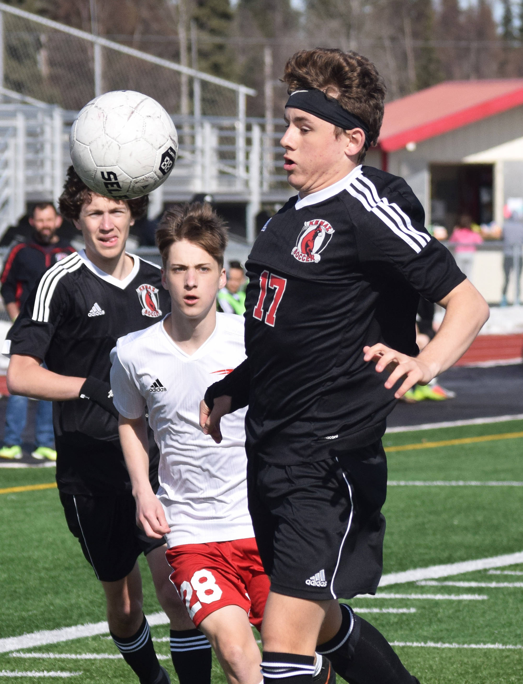Kenai's Travis Verkuilen (17) gets his chest on a ball Saturday, April 13, 2019, in a nonconference game against North Pole at Kenai Central High School. (Photo by Joey Klecka/Peninsula Clarion)