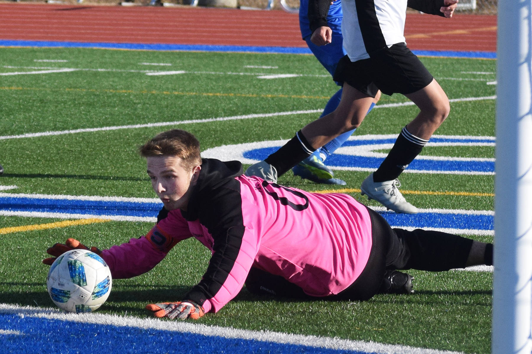 Nikiski goalkeeper Michael Eiter corrals a save Tuesday in a Peninsula Conference game at Soldotna High School. (Photo by Joey Klecka/Peninsula Clarion)