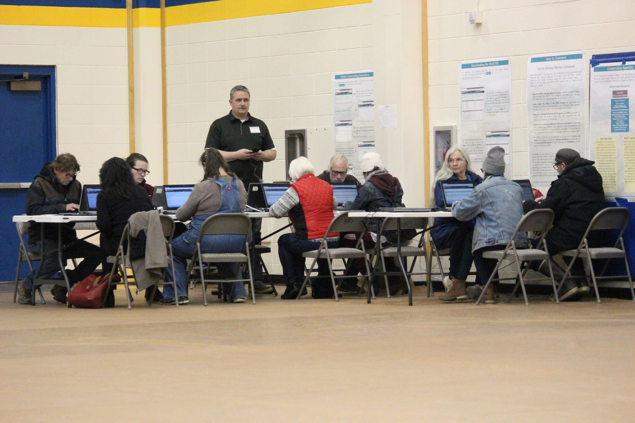 Community members submit comments about the Draft EIS for the proposed Pebble Mine to the Army Crops of Engineers through computers set up at an April 11, 2019 public hearing at Homer High School in Homer, Alaska. (Photo by Megan Pacer/Homer News)