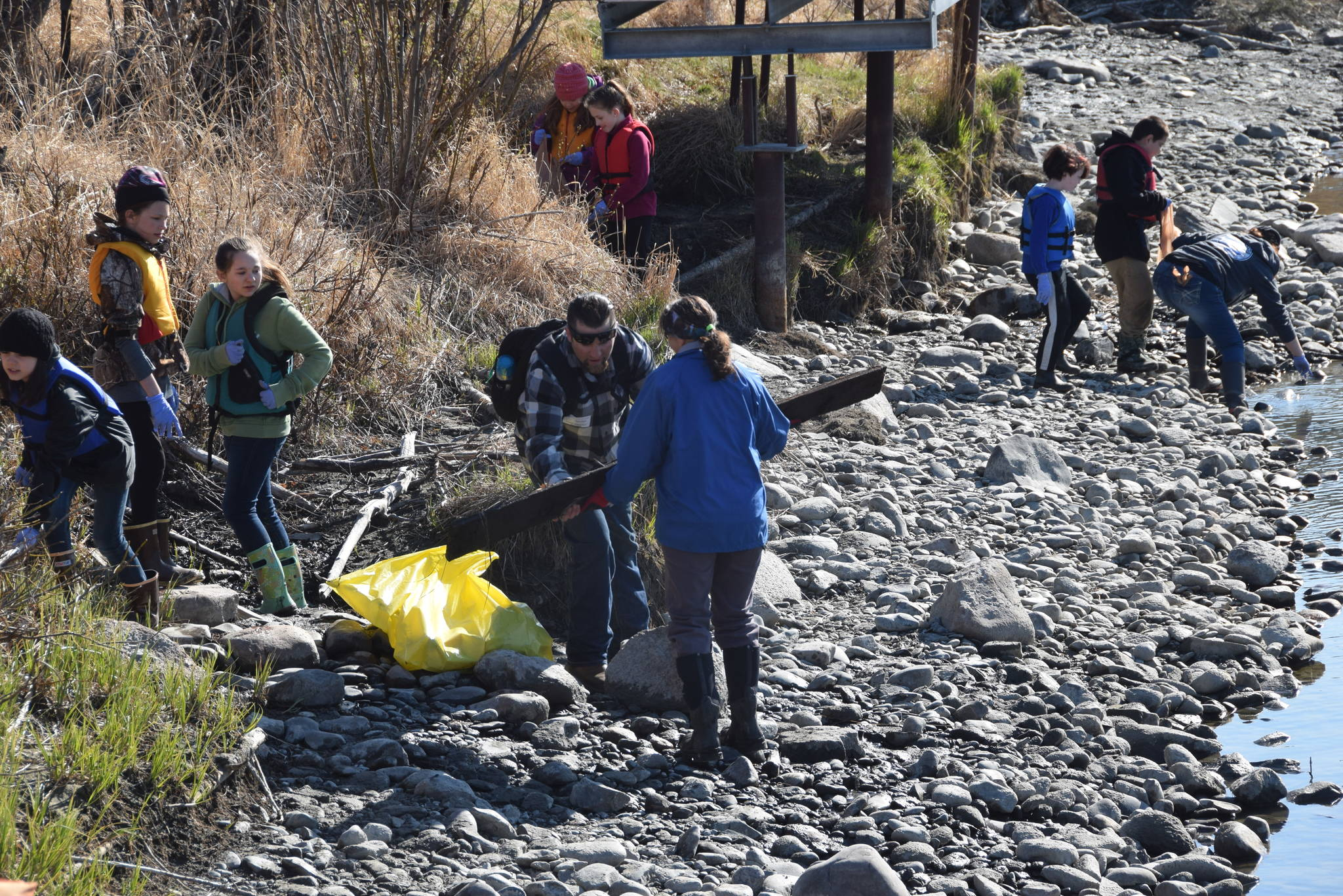 Students from Redoubt Elementary pick up trash along the river during the 6th Annual Kids Kenai River Spring Cleanup at Swiftwater Park in Soldotna, Alaska on May 3, 2019. (Photo by Brian Mazurek/Peninsula Clarion)